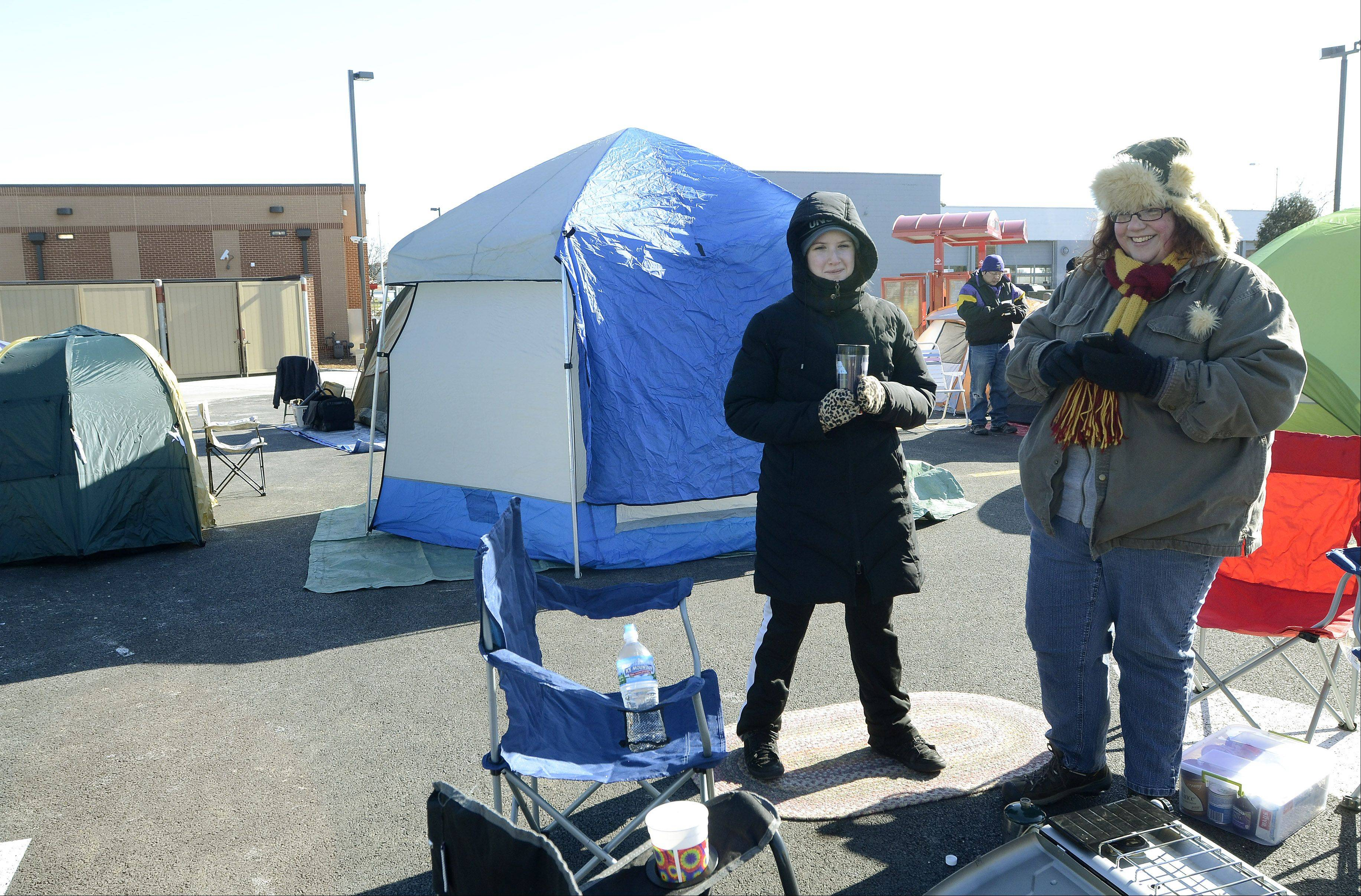 Linda Foertsch, left, of Addison and Jennifer Floyd of Oak Lawn, camp out Wednesday in a tent city at the new Mount Prospect Chick-fil-A.