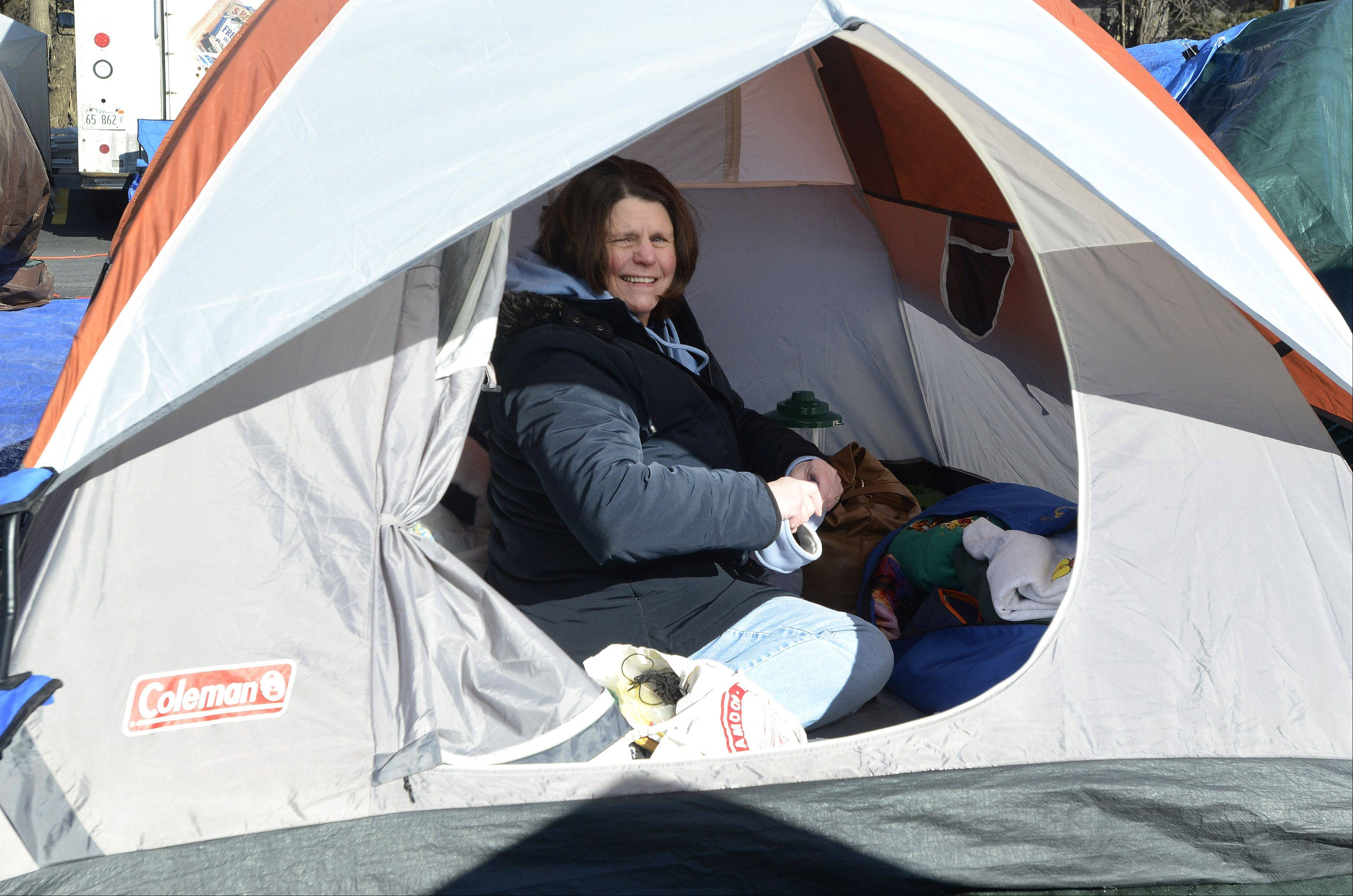 Gale Ahrens of Plainfield camps out Wednesday with family and friends in a tent city at the new Mount Prospect Chick-fil-A.