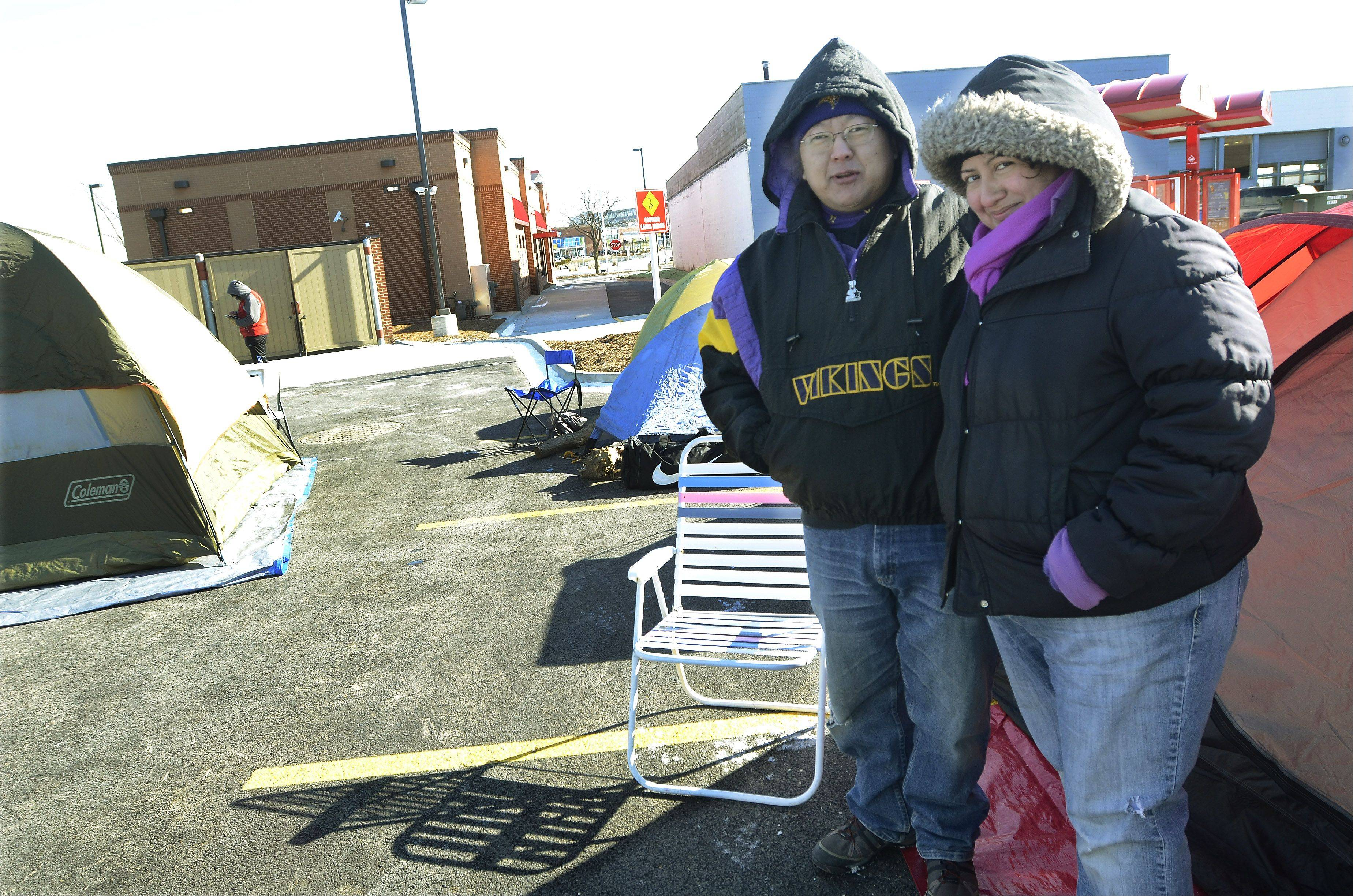 Nuno and Laura Schmidt of Mount Prospect camp out in the tent city at a new Mount Prospect Chick-fil-A.