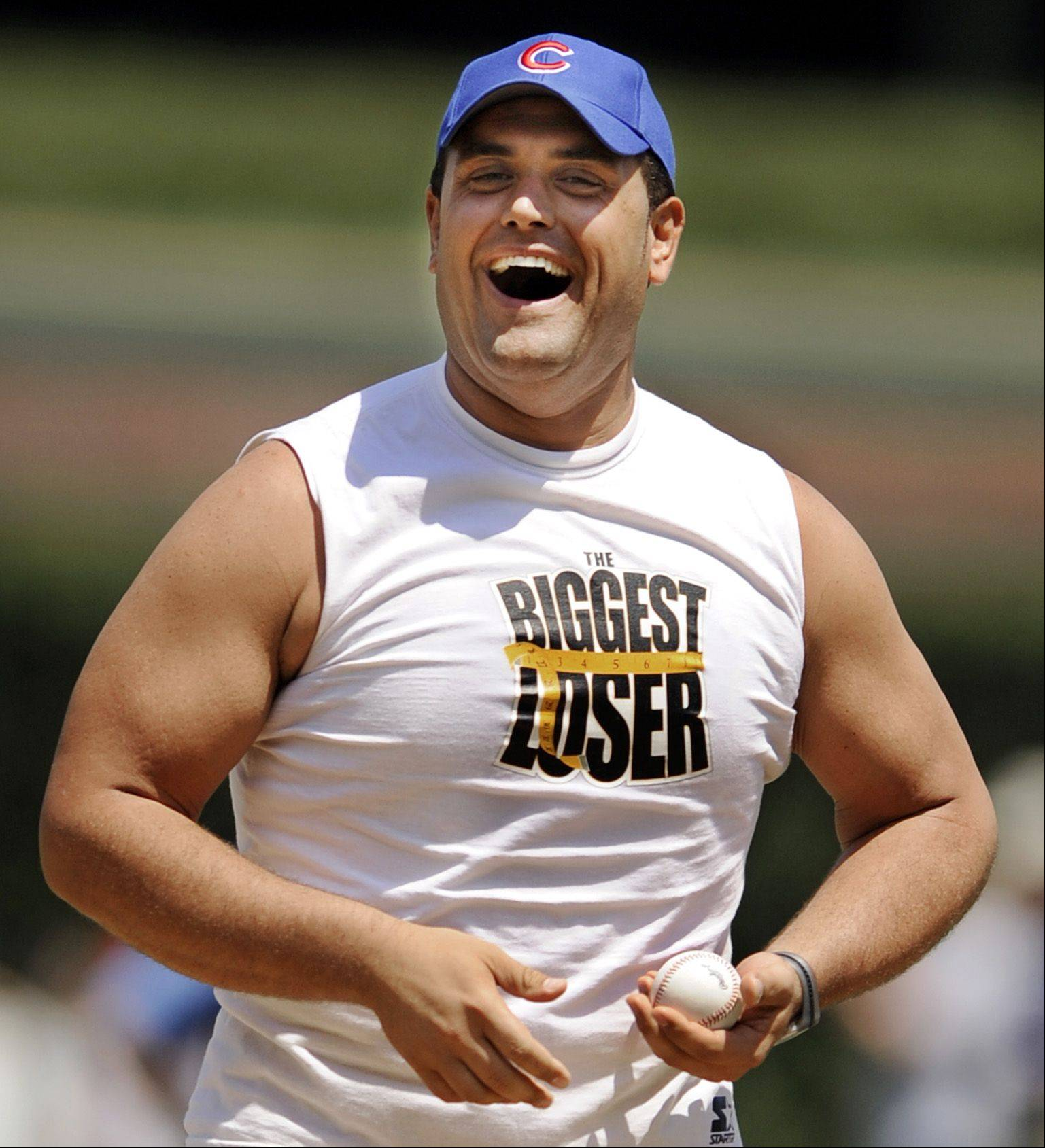 """The Biggest Loser"" winner Michael Ventrella, of Bartlett, seen here throwing out the first pitch at a 2010 Chicago Cubs game, said he can't wait to check out the new The Biggest Loser resort in Itasca."