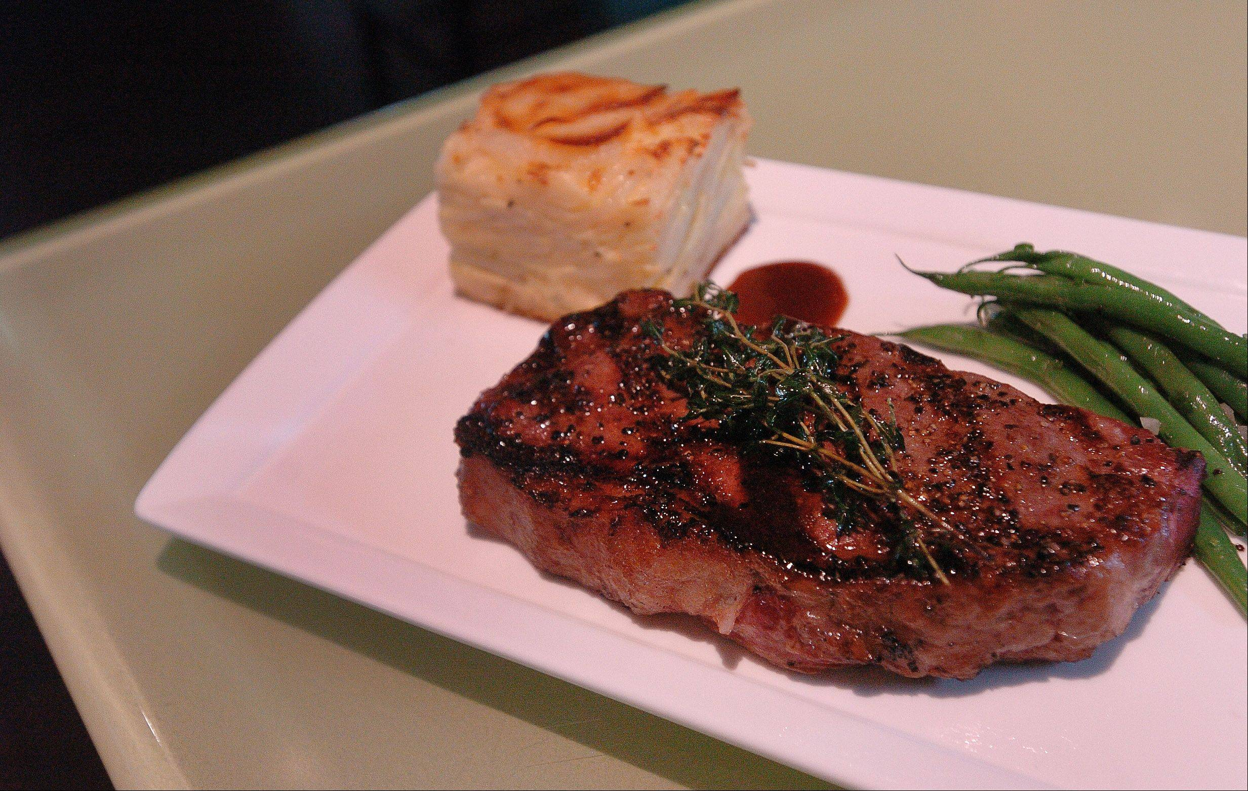 New York strip steak at Fresh 1800 comes with a gratin-like potato cake and crisp green beans.