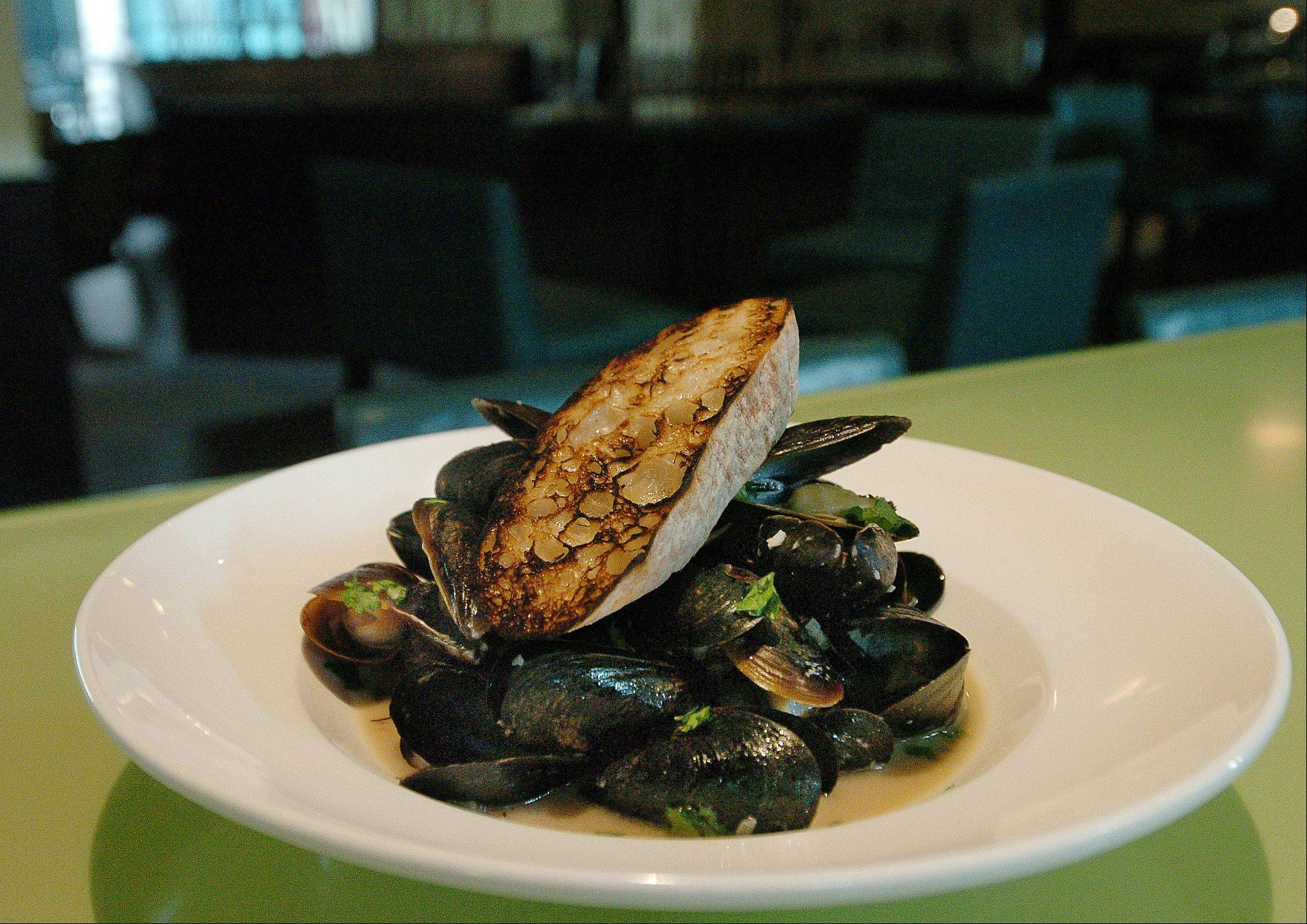 Mussels cook in white wine and herbs at Fresh 1800 at the Hyatt Regency Schaumburg.