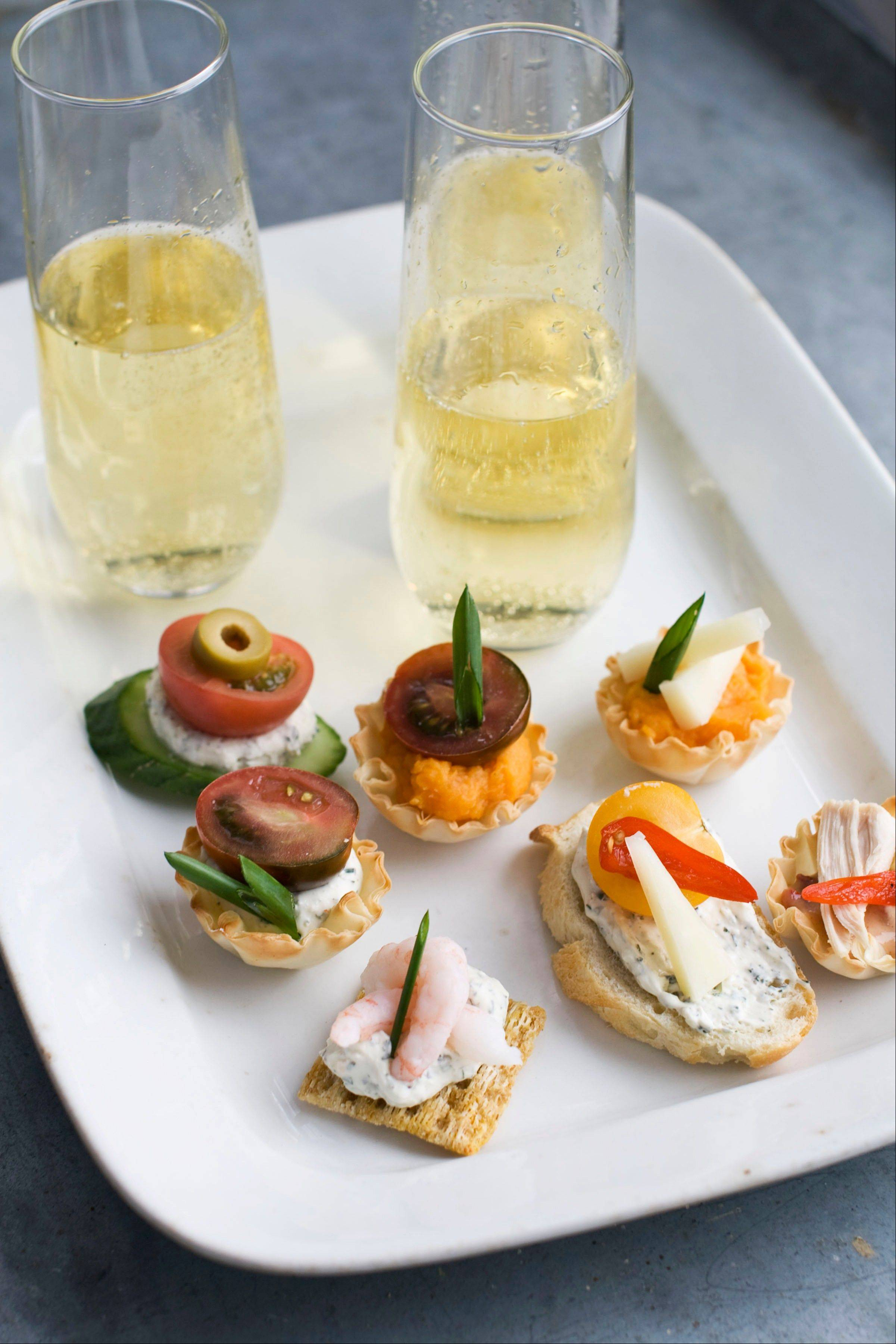 Using a building block approach to Oscar party canapes, guests can select from a buffet of ingredients -- from bases and spreads to toppings and garnishes -- to design snacks that suit their preferences.