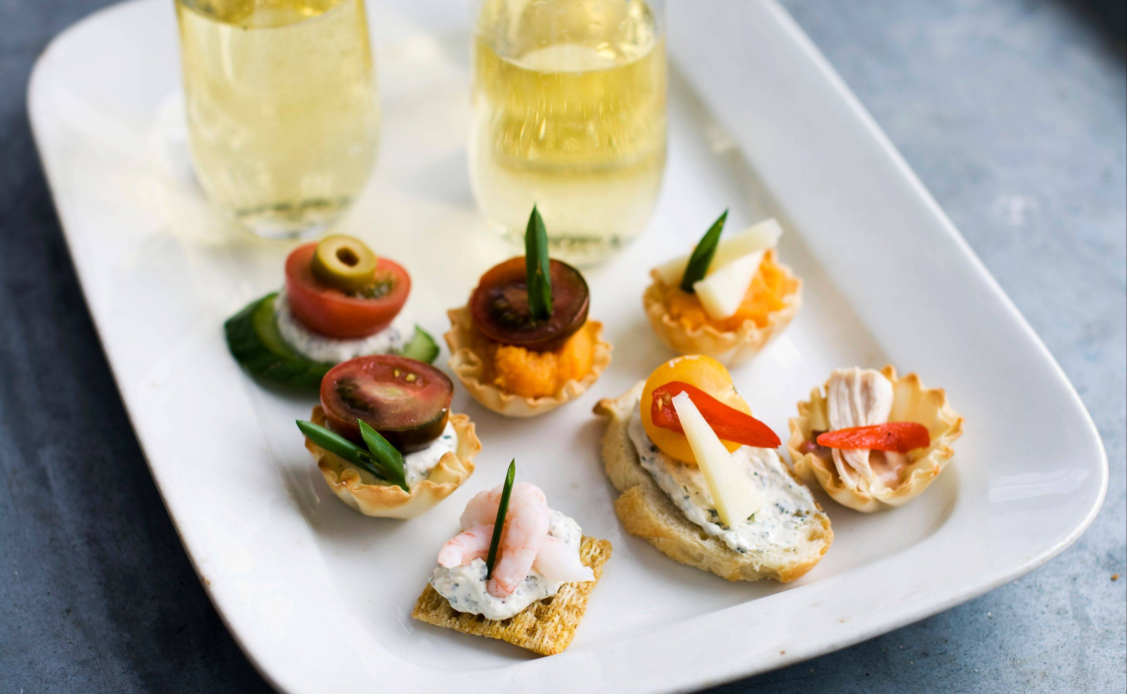 Using a building block approach to Oscar party canapes, diners are able to select from a buffet of ingredients -- from bases and spreads to toppings and garnishes -- to design snacks that suit their preferences.