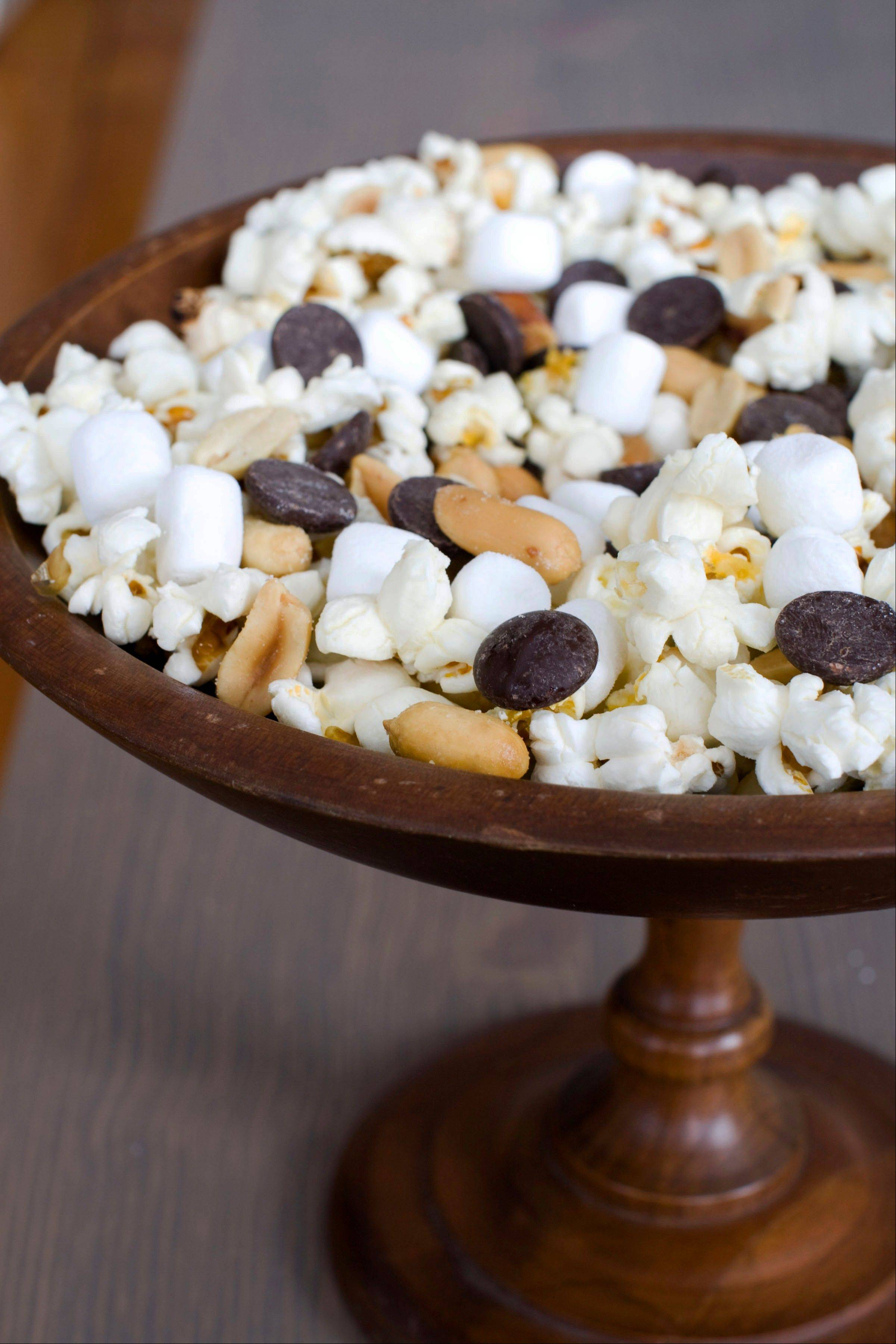 Mini marshmallows, chocolate chips and salted peanuts dress up popcorn for Oscar night.