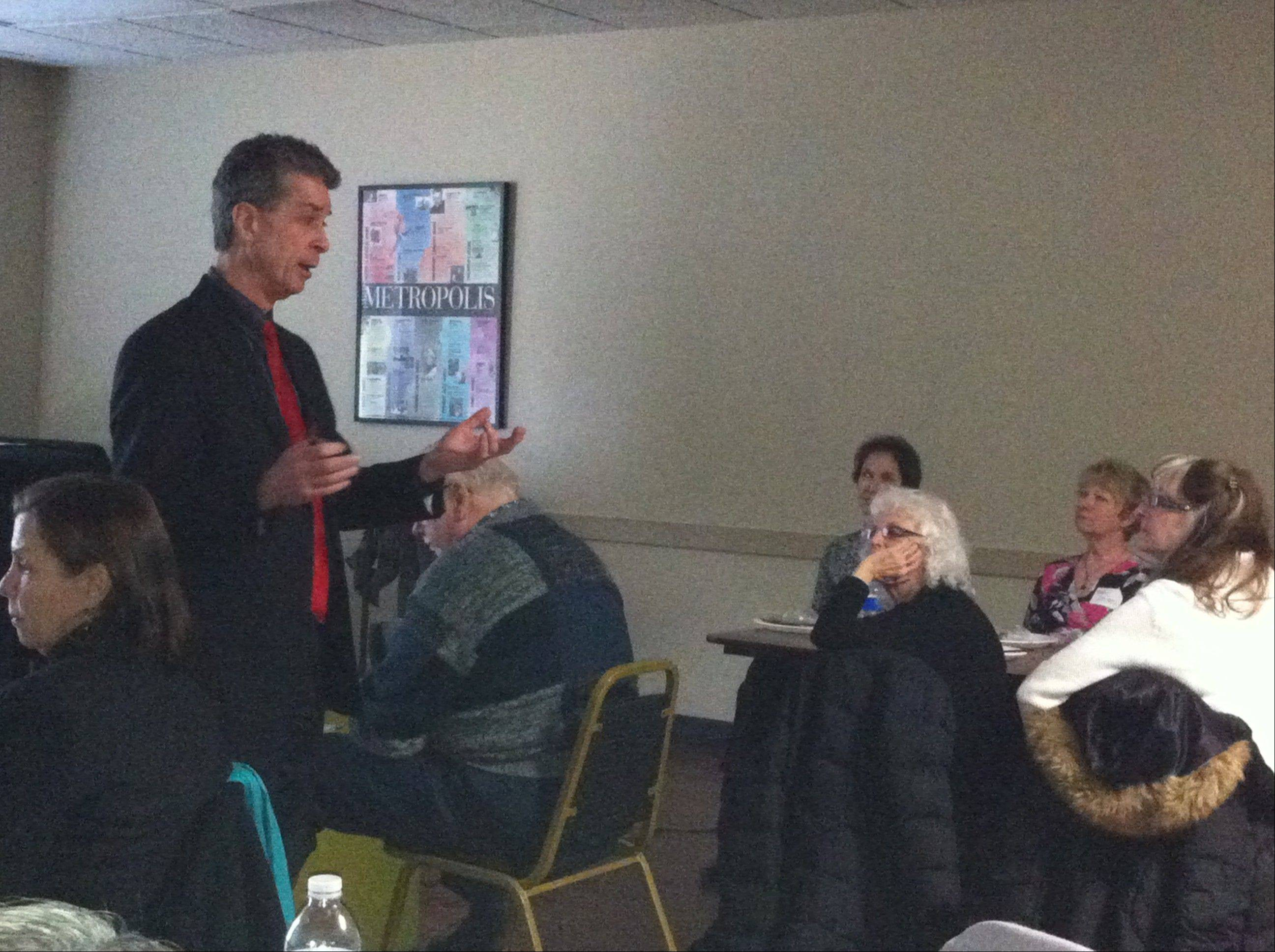 Daily Herald Film Critic Dann Gire discusses his Oscar predictions with the Arlington Heights Chamber of Commerce's Professional Women's Council during the groups monthly lunch meeting Wednesday.