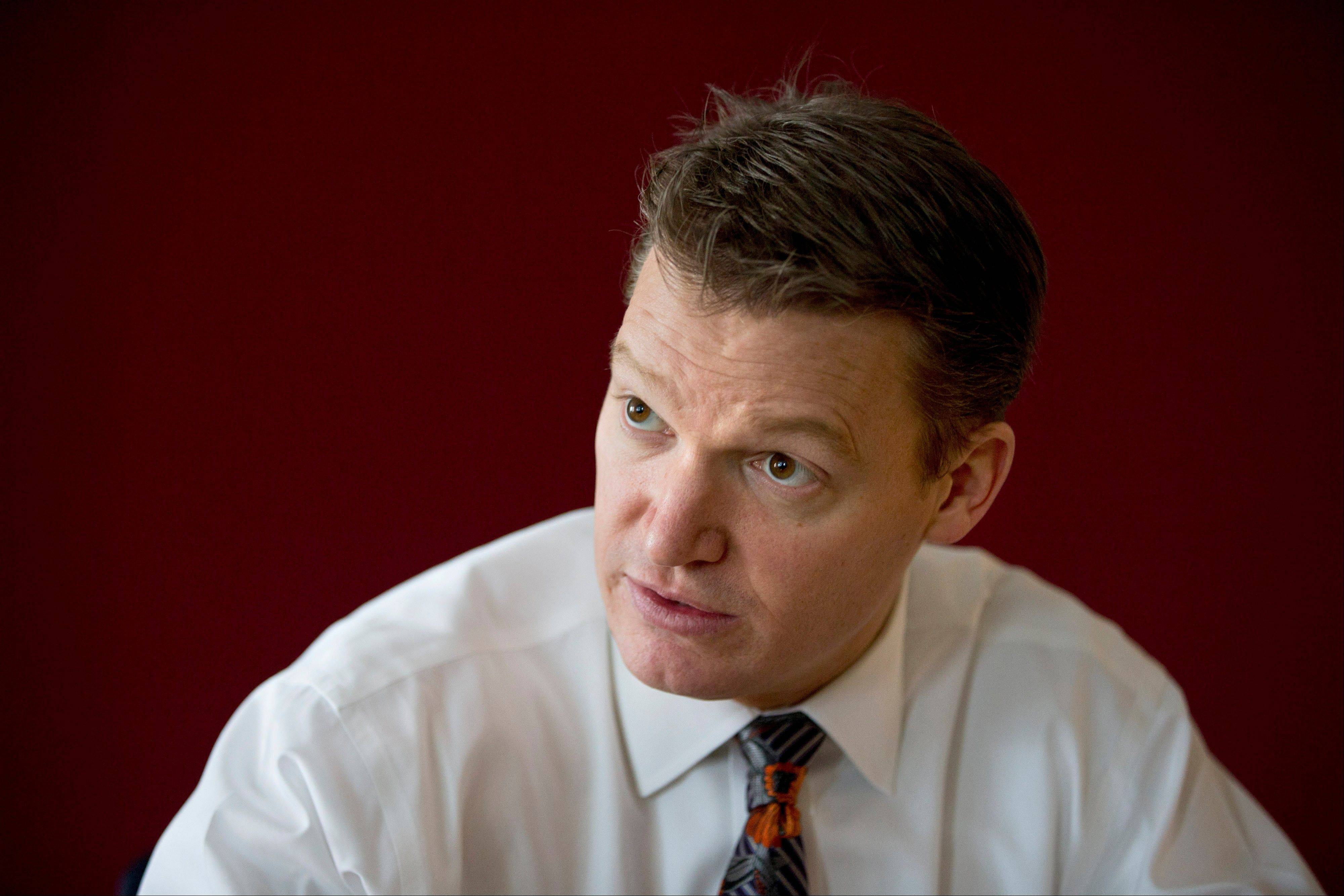 Mandiant founder and CEO Kevin Mandia is seen in his office in Alexandria, Va., Wednesday. His private technology security firm described in extraordinary detail efforts it blamed on a Chinese military unit to hack into 141 businesses, mostly inside the U.S., and steal commercial secrets. China denies the claim.