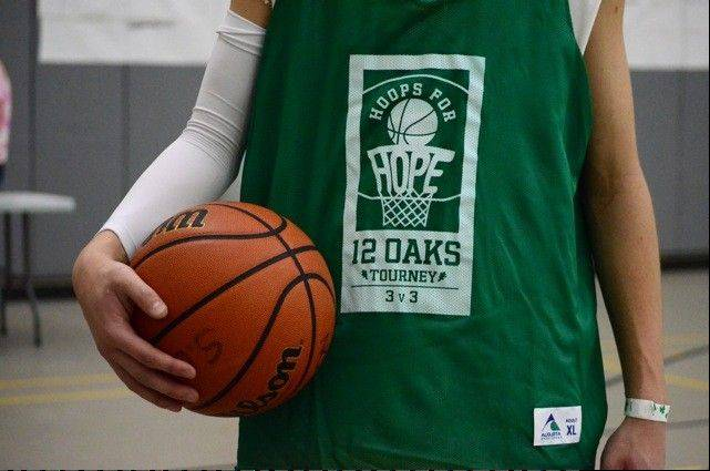 A player in the 2012 tournament sports the official Hoops for Hope jersey.