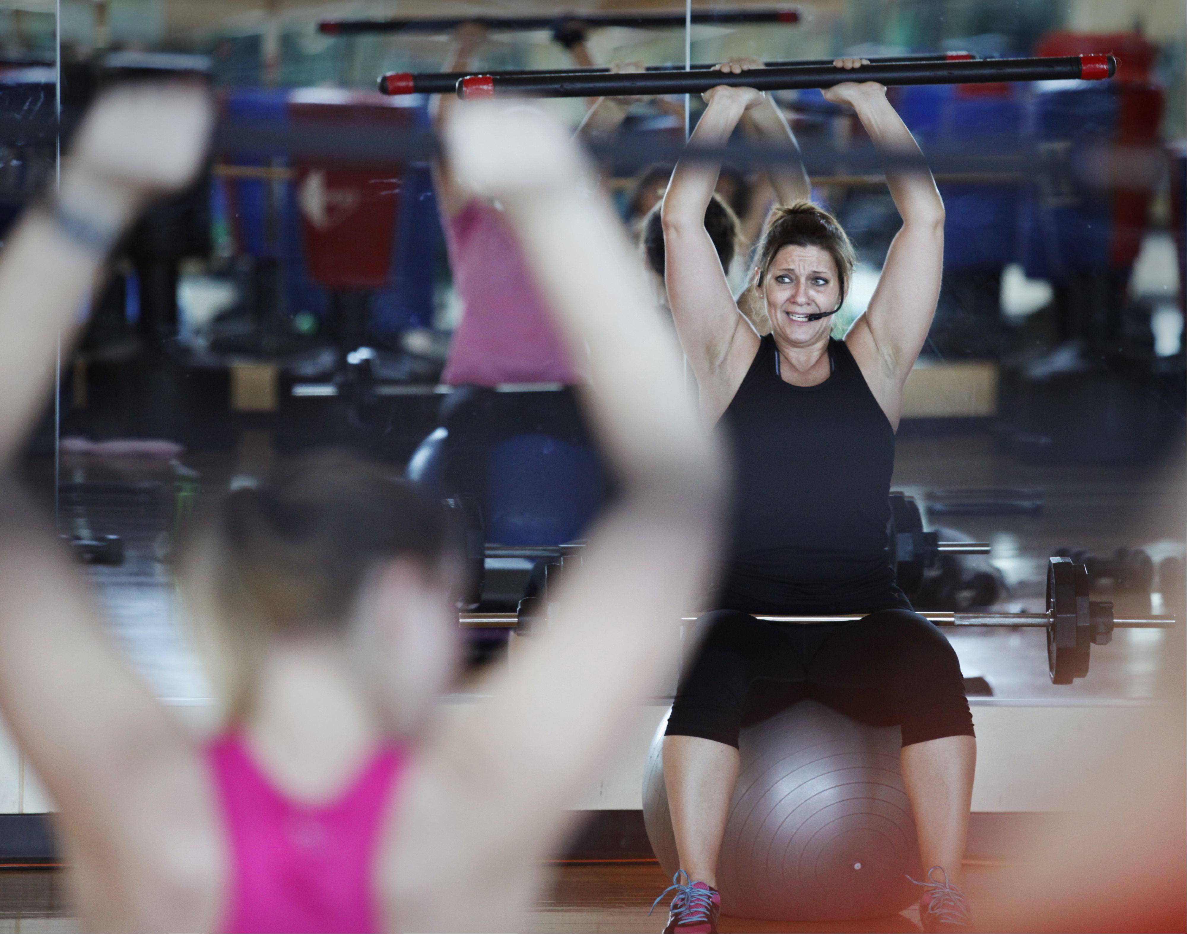 "Class instructor Carrie Baldwin leads students in weight training exercises on a recent Friday at The Centre of Elgin. Officials hope to set an attendance record for Elgin's ""Largest Family Fitness Class"" March 1."