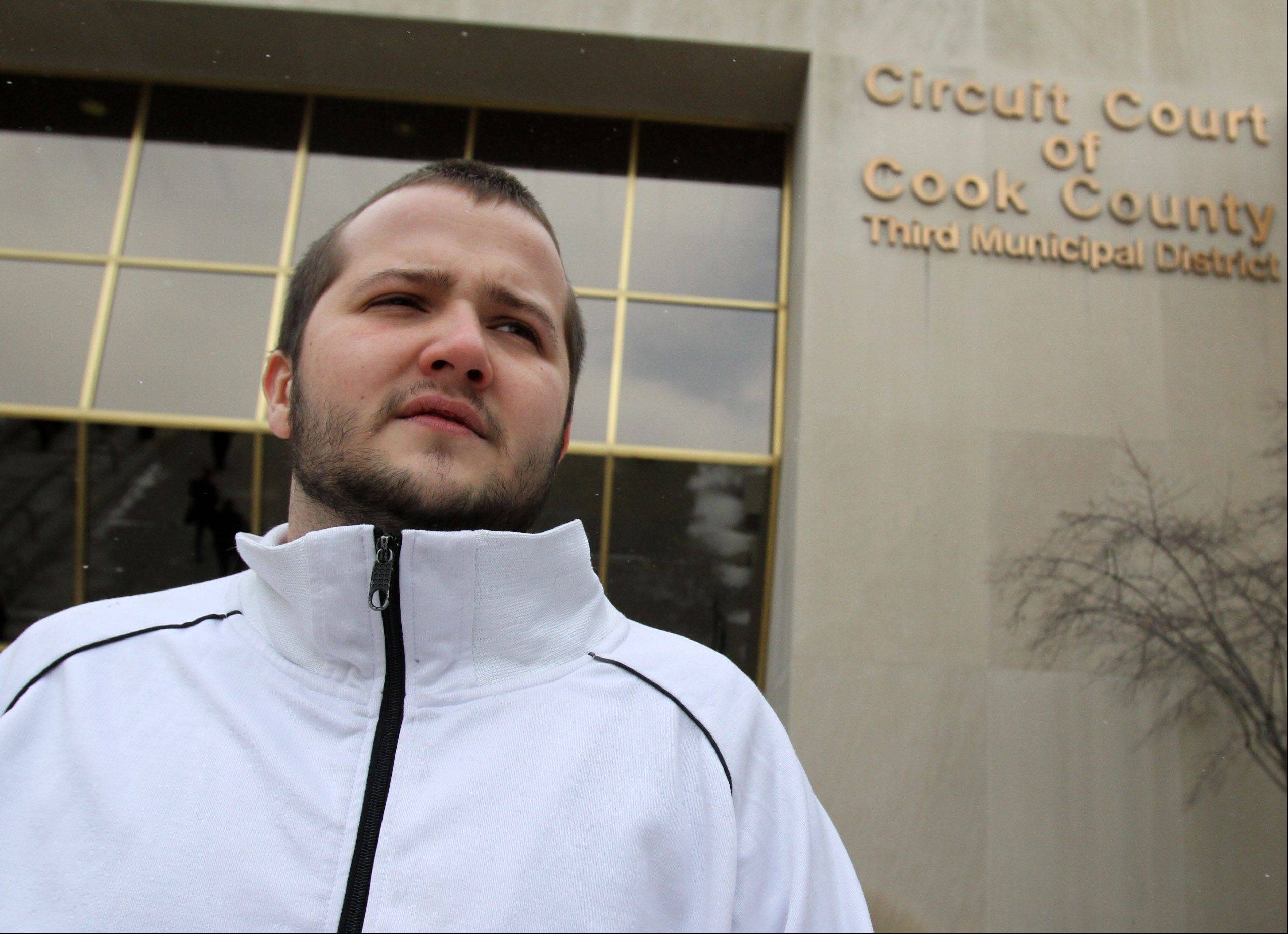 Russell Disney of Palatine stands at the Third Municipal District Courthouse in Rolling Meadows. Charges against Disney were dismissed due to the involvement of former Schaumburg undercover police officers now accused of drug conspiracy.