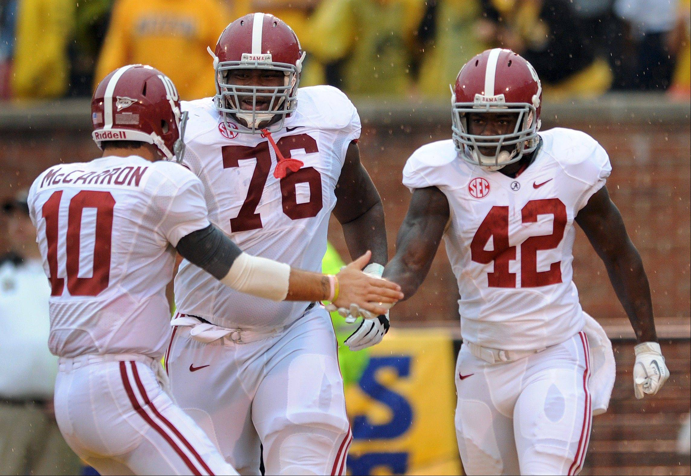 Alabama offensive lineman D.J. Fluker (76) is projected on some NFL mock draft boards to be a first-round pick for the Chicago Bears, who also have needs at tight end and defensive line.