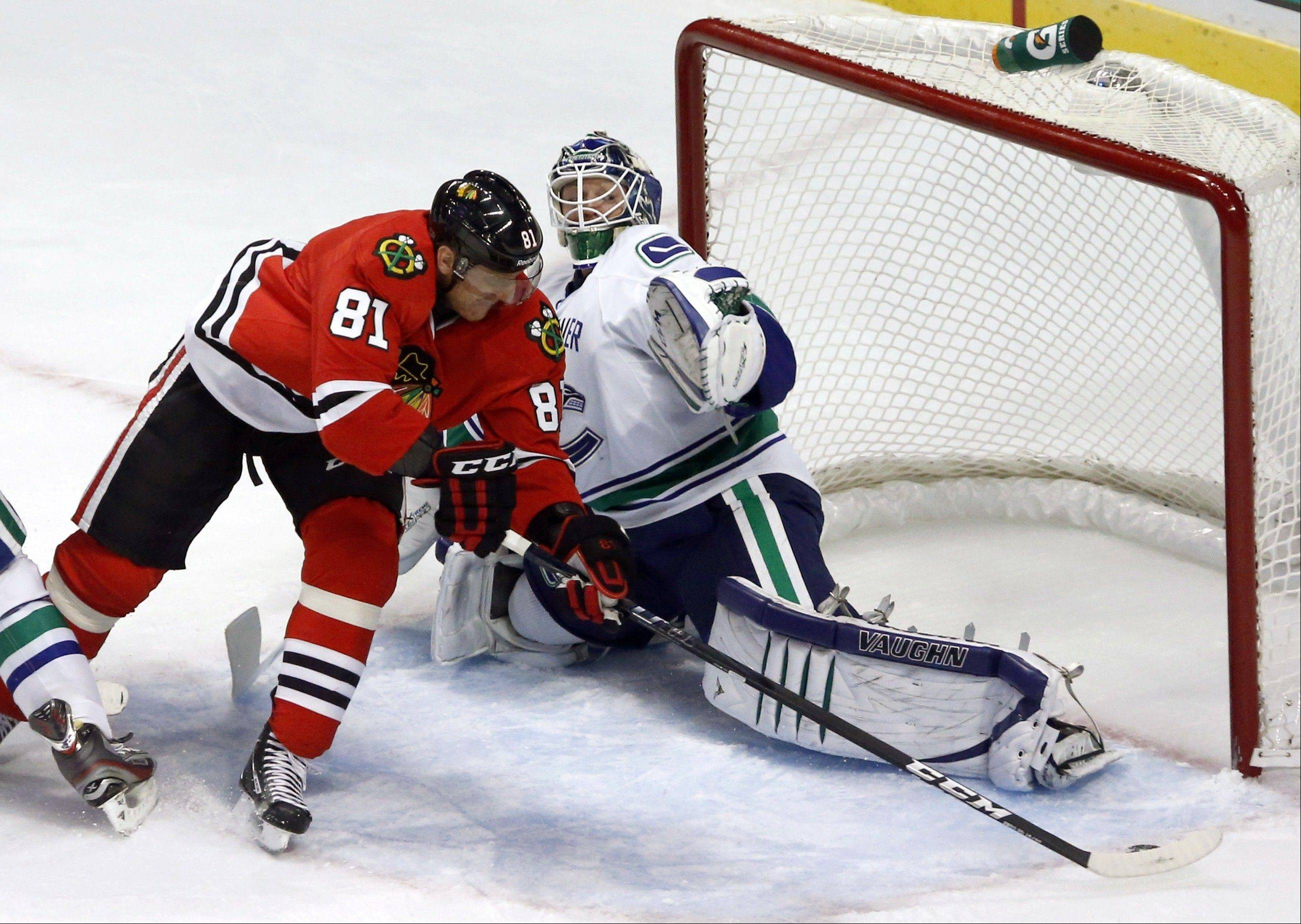 Chicago Blackhawks right wing Marian Hossa skates past Vancouver Canucks goalie Cory Schneider to score his second goal in the second period.