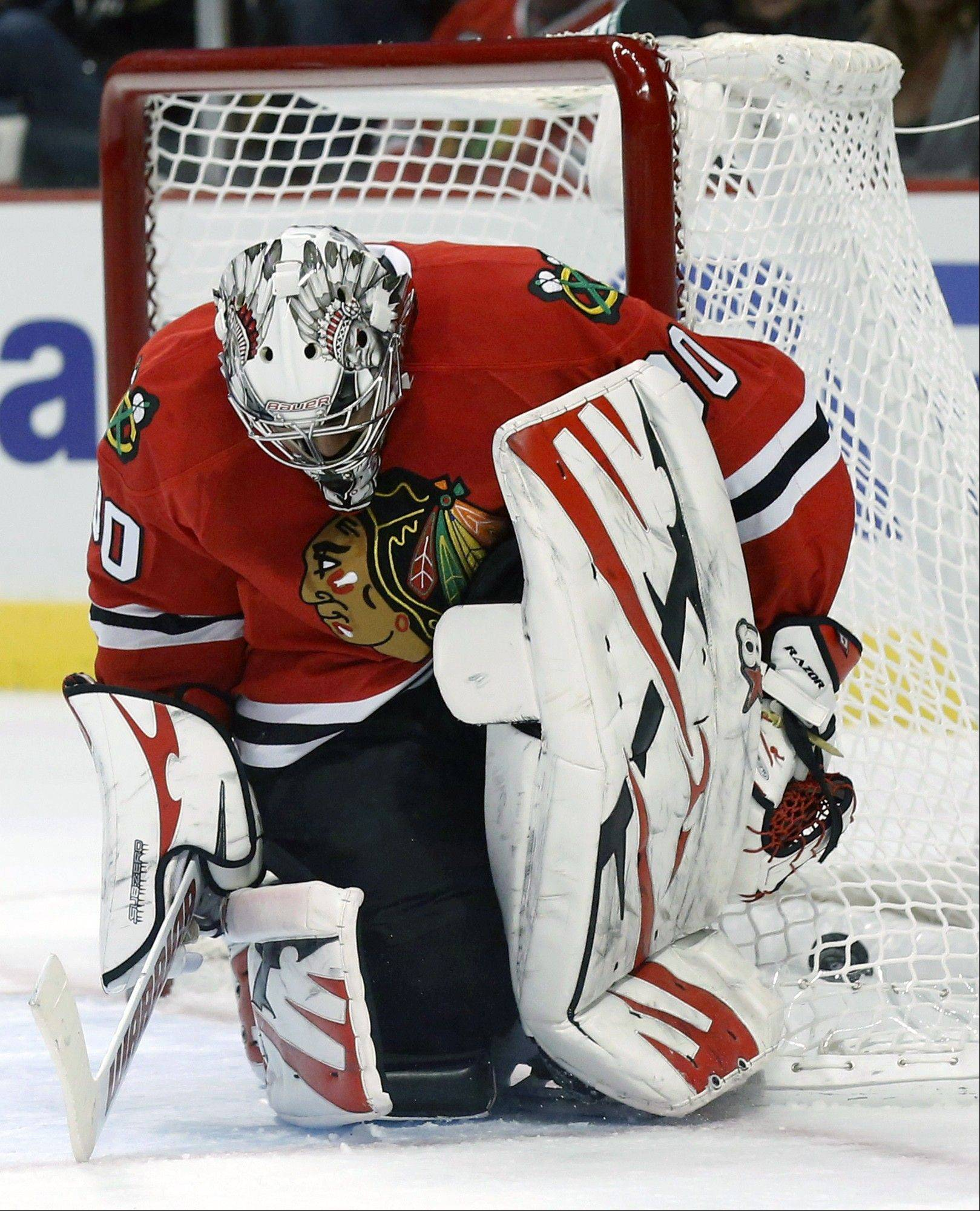 Chicago Blackhawks goalie Ray Emery looks down after giving up a goal to Vancouver Canucks' Daniel Sedin during the first period.