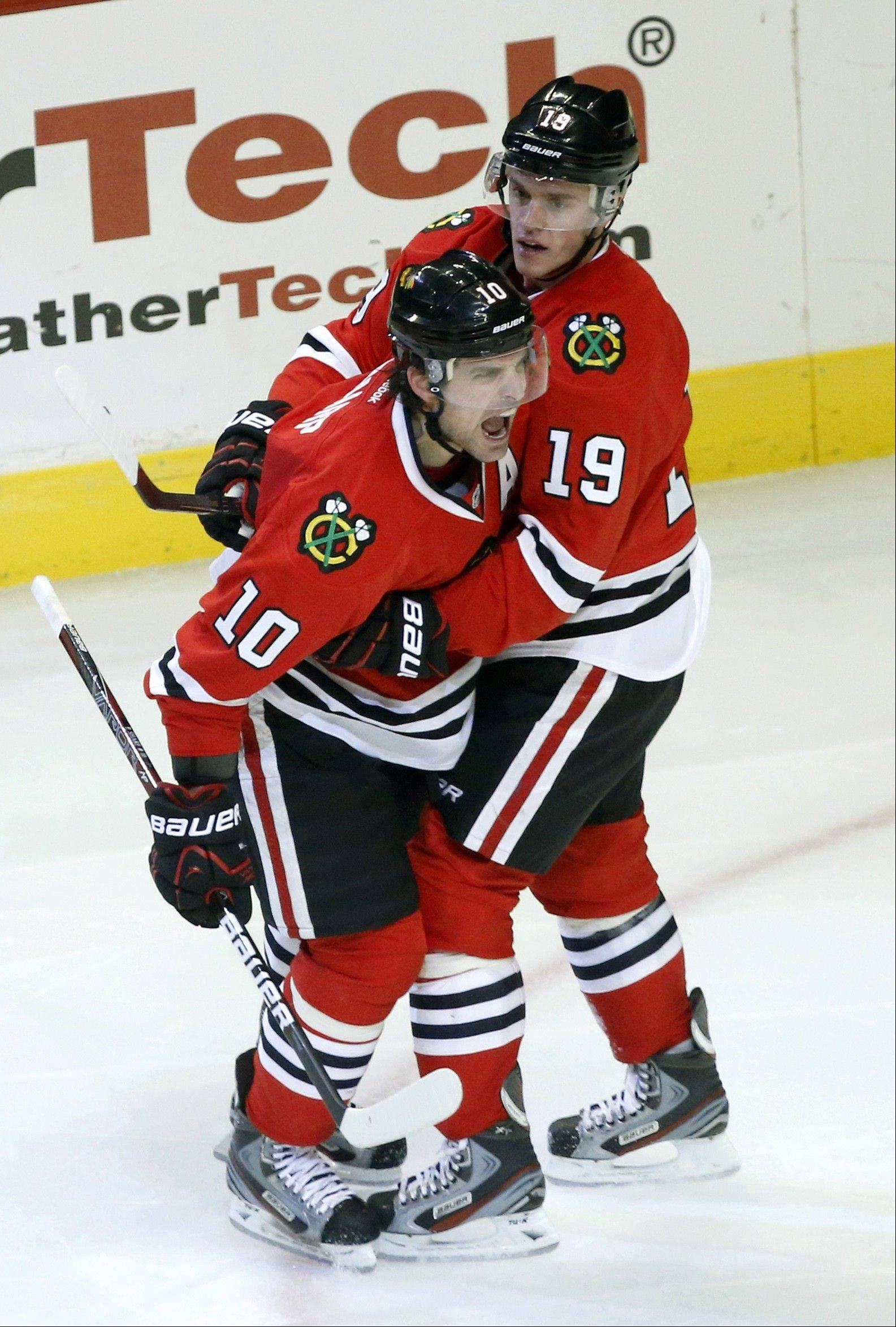 Chicago Blackhawks center Patrick Sharp celebrates his goal with Jonathan Toews during the second period .