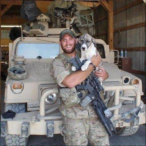 Army Sgt. Tim Johannsen and his battle buddy, Leonidas, in Afghanistan in 2011. The Puppy Rescue Mission helped Johannsen bring Leonidas to live in Downers Grove with his wife, Kaydee, and her family while he finished his combat tour. They were reunited in 2012 and now live in Hawaii, where Johannsen is stationed.