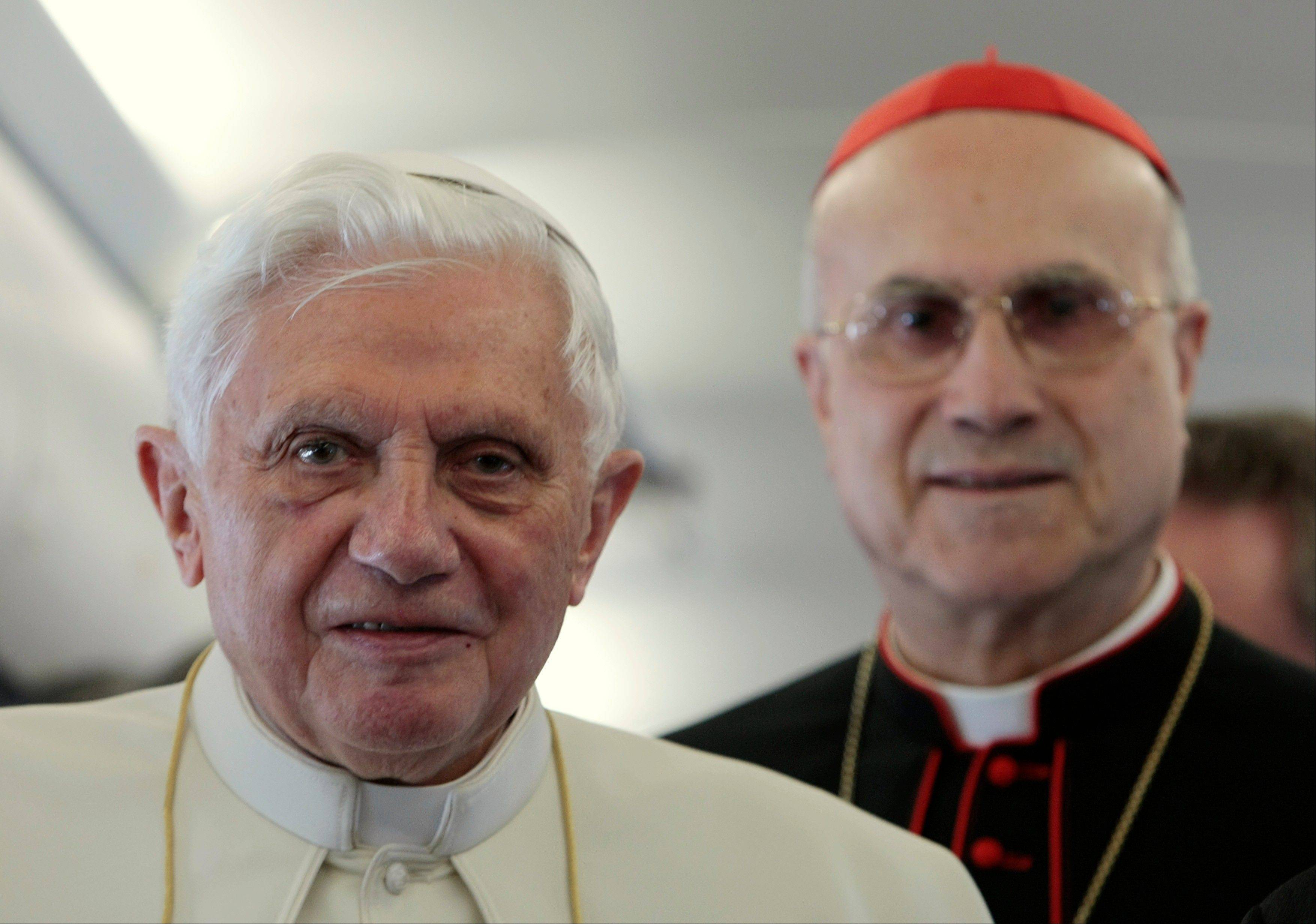 Pope Benedict XVI, left, was well aware of the problems in the internal governance of the Catholic Church, having spent nearly a quarter-century in the Vatican's Congregation for the Doctrine of the Faith. But he never entered into the Vatican's political fray as a cardinal — and as pope left it to his No. 2, Cardinal Tarcisio Bertone, to do the job.