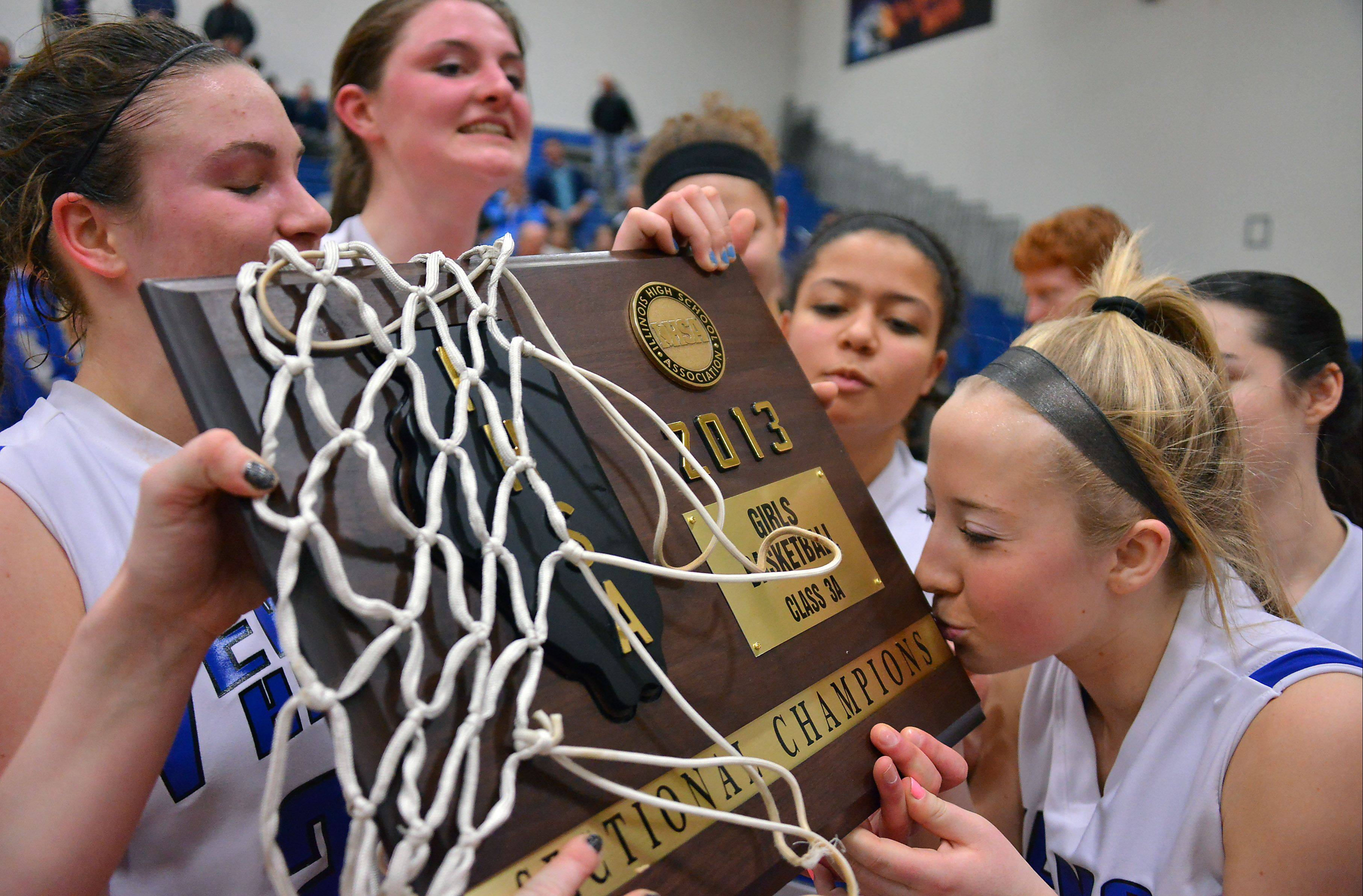 Vernon Hills' Haley Lieberman kisses the sectional championship plaque after she and her teammates topped Regina Dominican in the Class 3A final at Vernon Hills on Thursday.