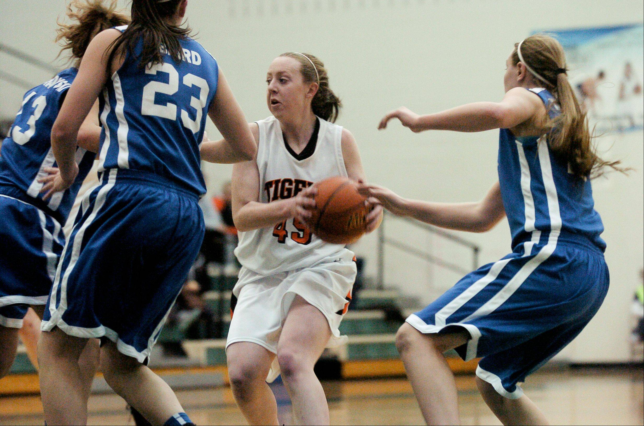 Meghan Waldron of Wheaton Warrenville South heads to the basket against Wheaton North.