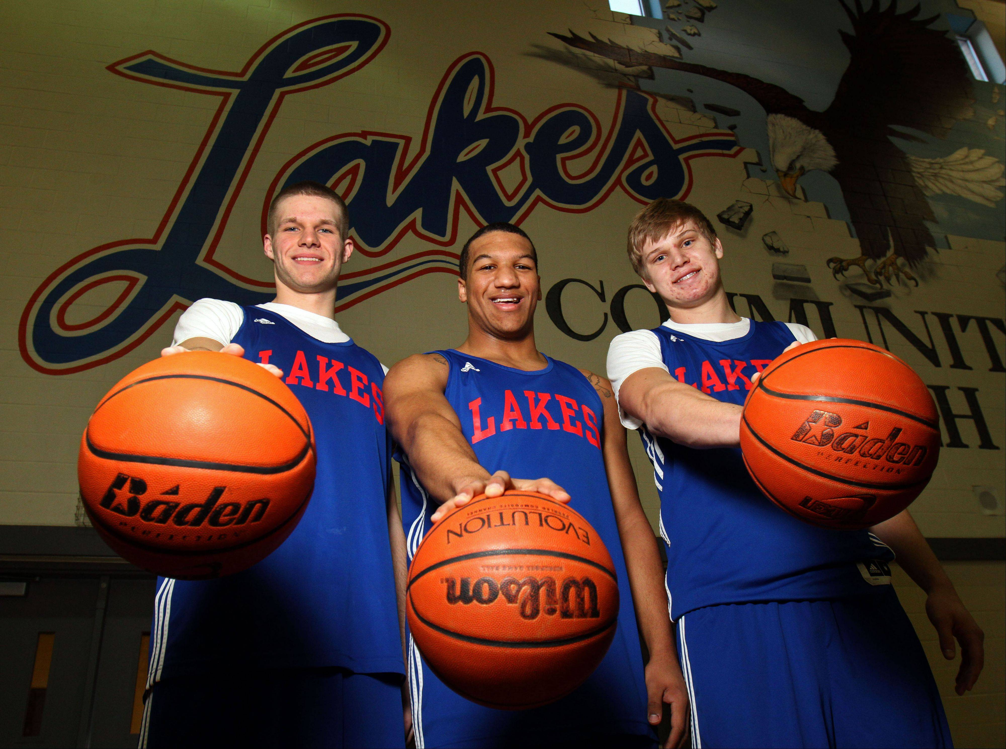 From left, Lakes seniors Jake Kohler, Direll Clark and Justin Bergeron have played a huge part in the team's record-setting season this winter.