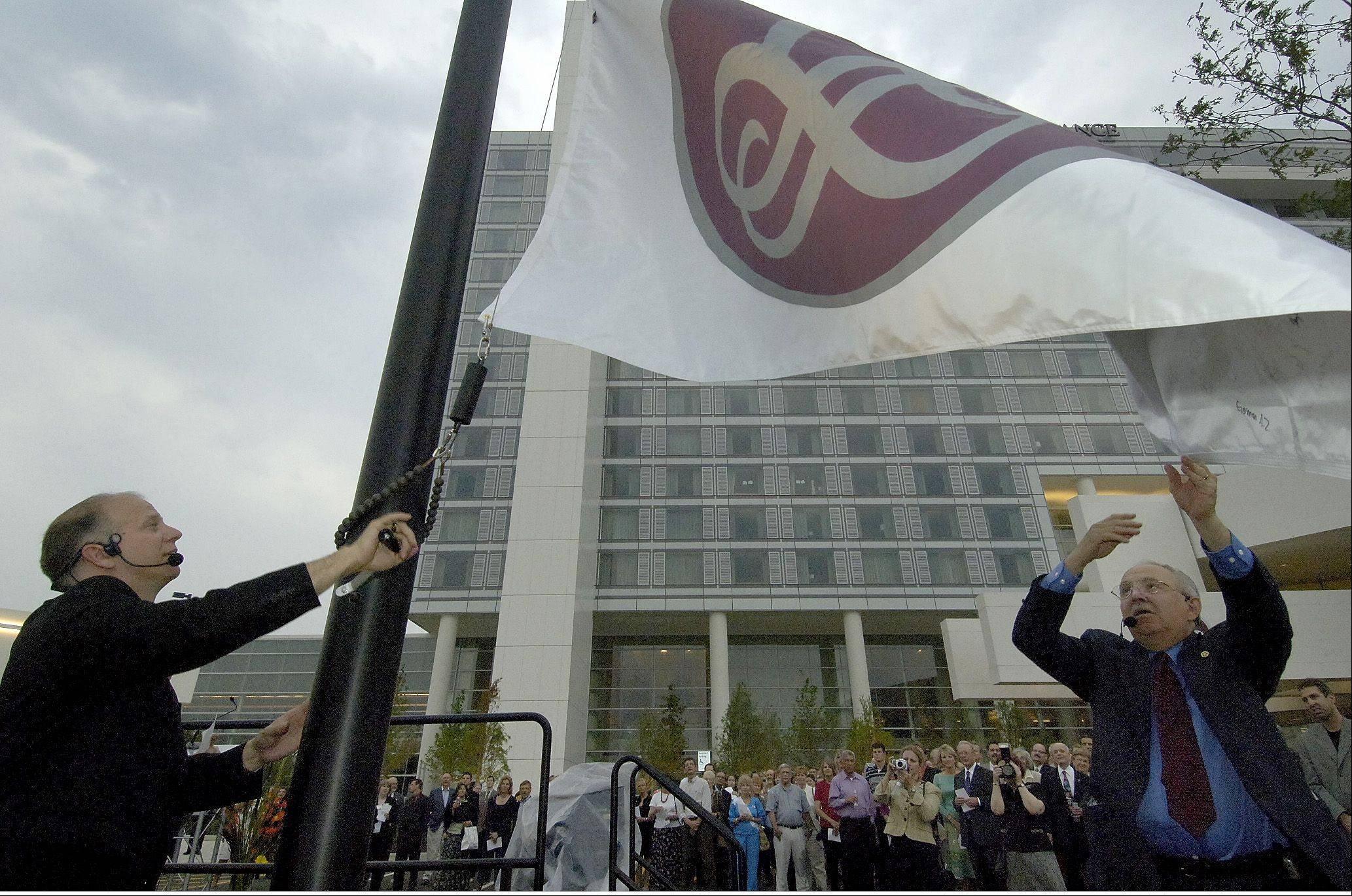 Renaissance Hotel's General Manager Tom Robertson, left, and Schaumburg Village President Al Larson raised the Renaissance Hotel flag during an opening ceremony at the 2006 grand opening of the Schaumburg Convention Center and Renaissance Hotel.