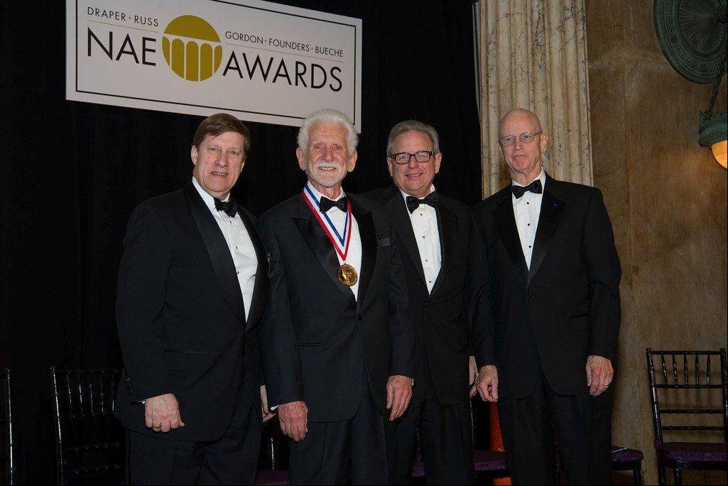 "COURTESY OF NATIONAL ACADEMY OF ENGINEERINGMartin Cooper, second from left, was honored by the National Academy of Engineering for leading a Motorola team to create the first cellphone in 1973. With him are James D. Shields, president and CEO of Draper Laboratory; from left, Cooper; Charles O. ""Chad"" Holliday Jr., chairman of the Council of the NAE; and Charles M. ""Chuck"" Vest, NAE president."