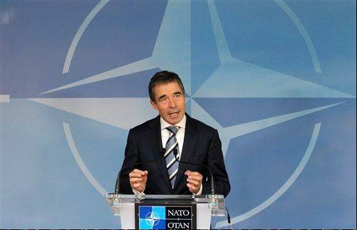 NATO Secretary General Anders Fogh Rasmussen addresses the media at NATO headquarters, in Brussels, Thursday.