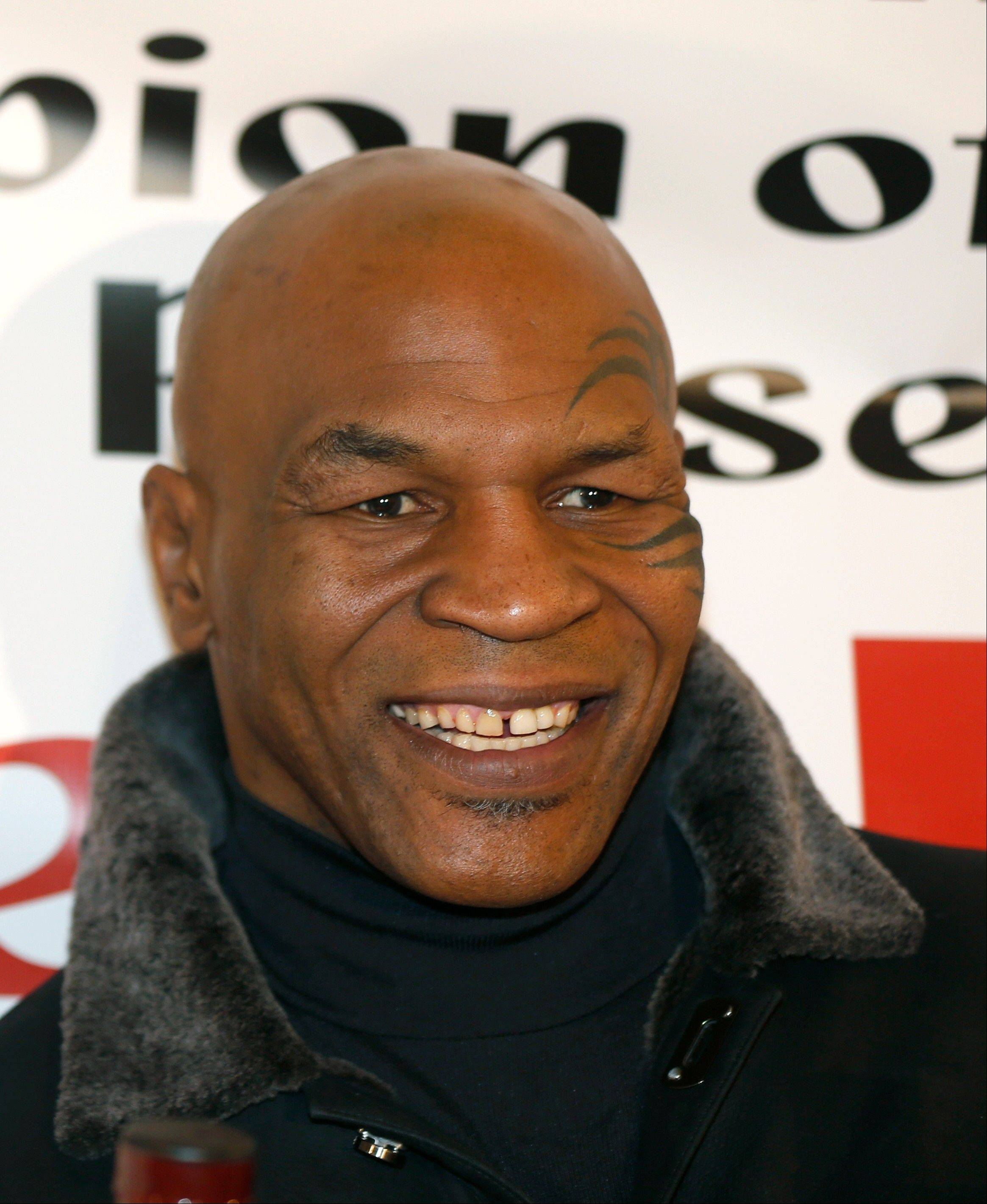 Former heavyweight champion Mike Tyson and his wife sued SFX Financial Advisory Management Services, a subsidiary of Live Nation Entertainment, on Wednesday claiming a former employee of the financial services company embezzled more than $300,000 from them and cost them millions in lucrative contracts.