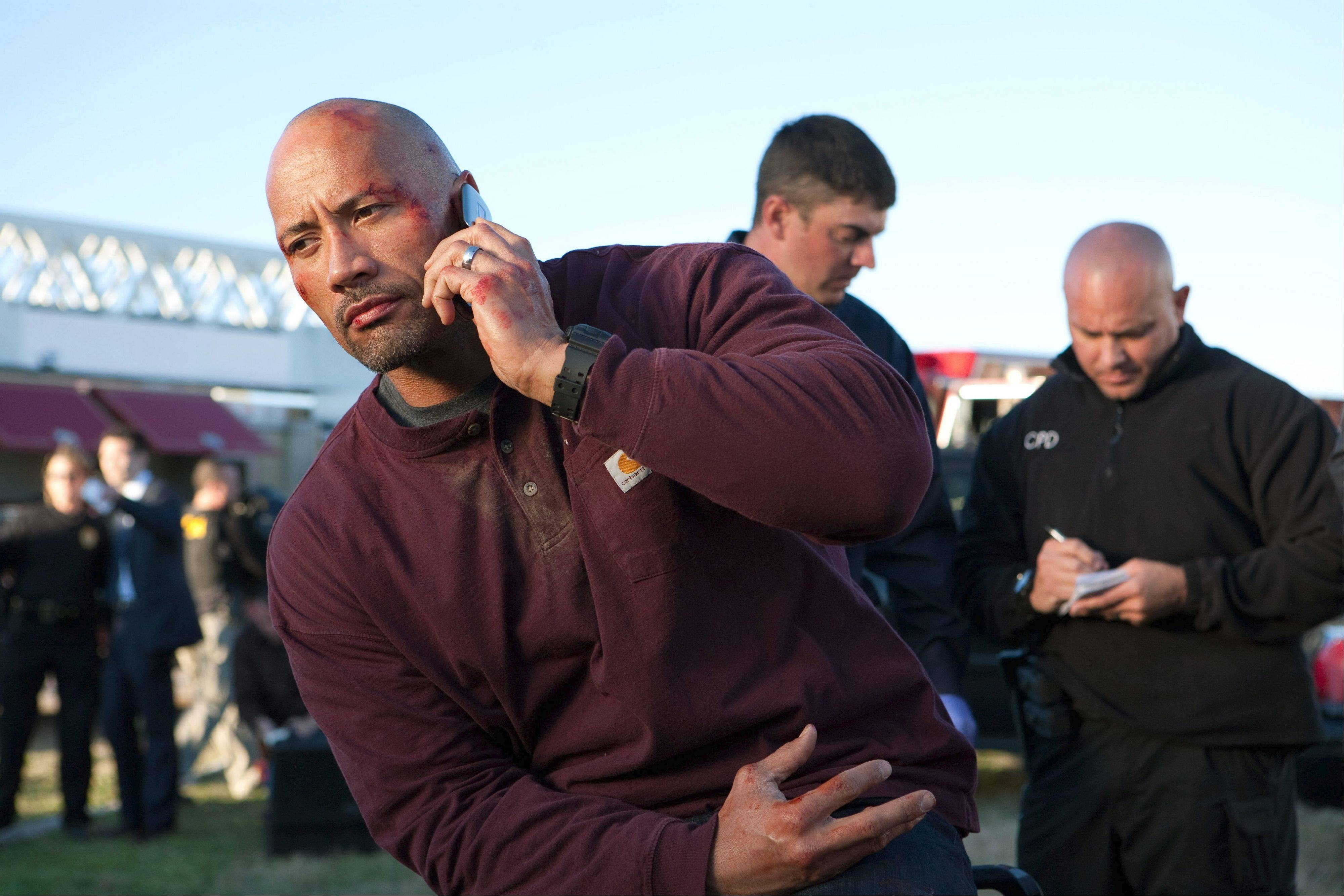 "Businessman John Matthews (Dwayne Johnson), left, makes a deal with a U.S. attorney to get his son out of jail in ""Snitch."""