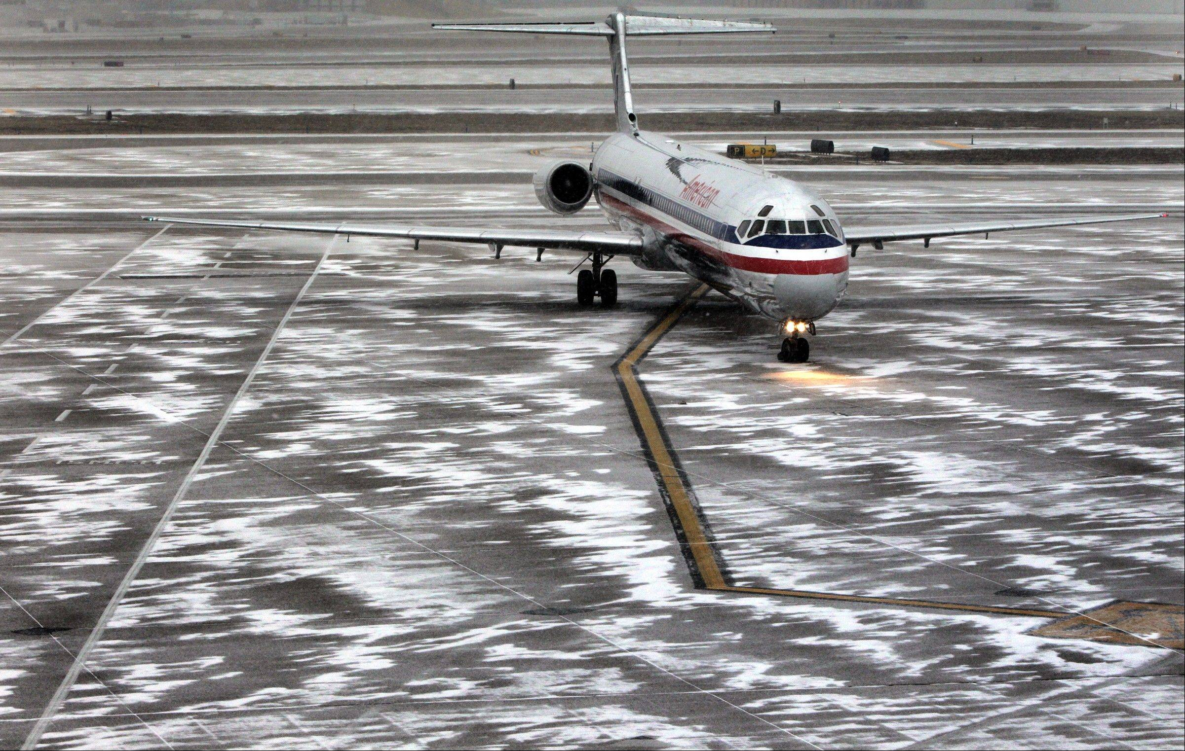 An American Airlines flight arrives as sleet falls at Lambert-St. Louis International Airport, on Thursday, Feb. 21, 2013. Blinding snow, at times accompanied by thunder and lightning, bombarded much of the nation's midsection Thursday. Freezing rain and sleet were forecast for southern Missouri, southern Illinois and Arkansas. St. Louis was expected to get all of the above � a treacherous mix of snow, sleet and freezing rain.