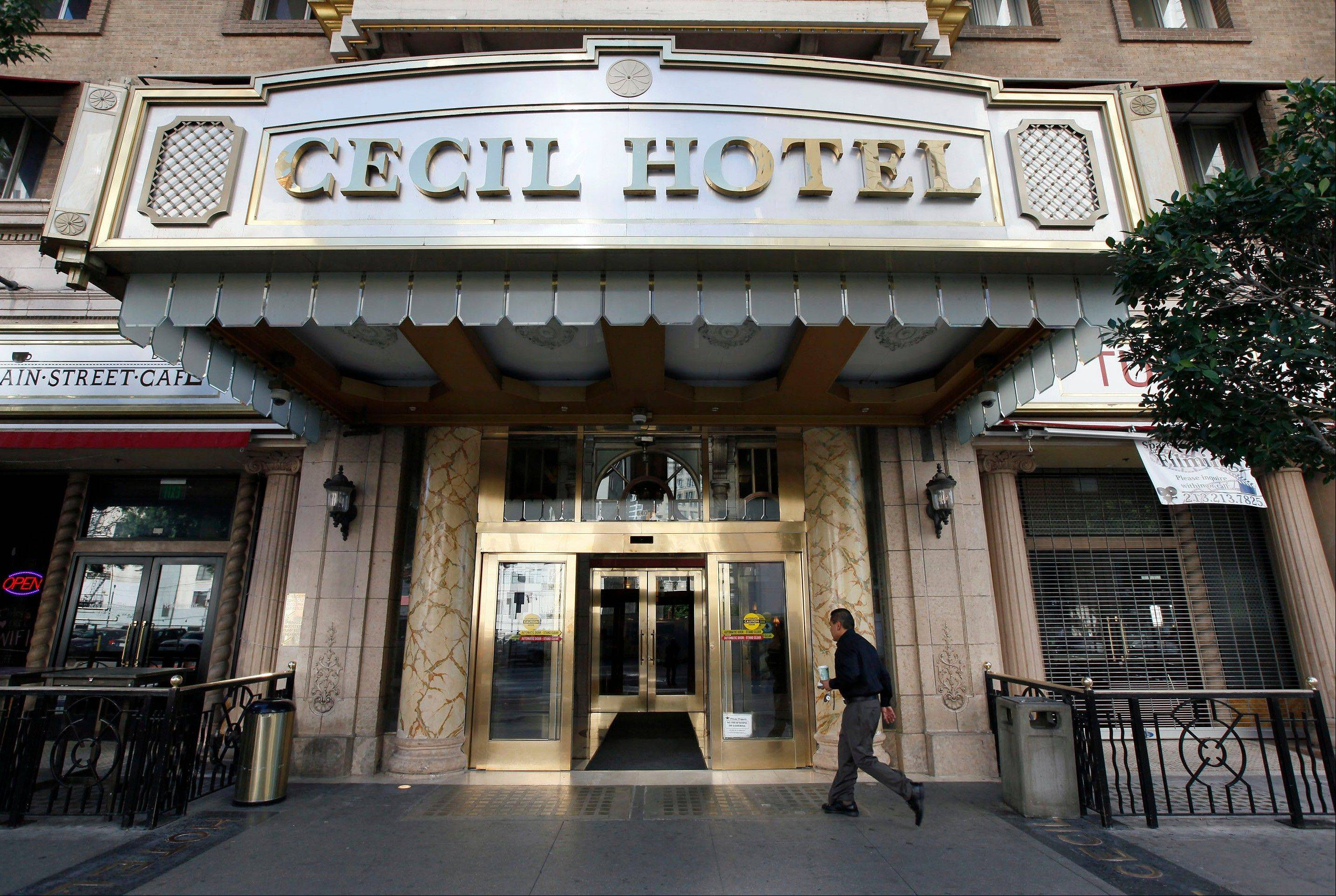 A visitor arrives at the Hotel Cecil, where police say the body of a woman was found wedged in one of the water tanks on the roof was that of a missing Canadian guest. Investigators used body markings to identify 21-year-old Elisa Lam, police spokeswoman Officer Diana Figueroa said late Tuesday. A maintenance worker at the Cecil Hotel found the body earlier in the day after guests complained of low water pressure.
