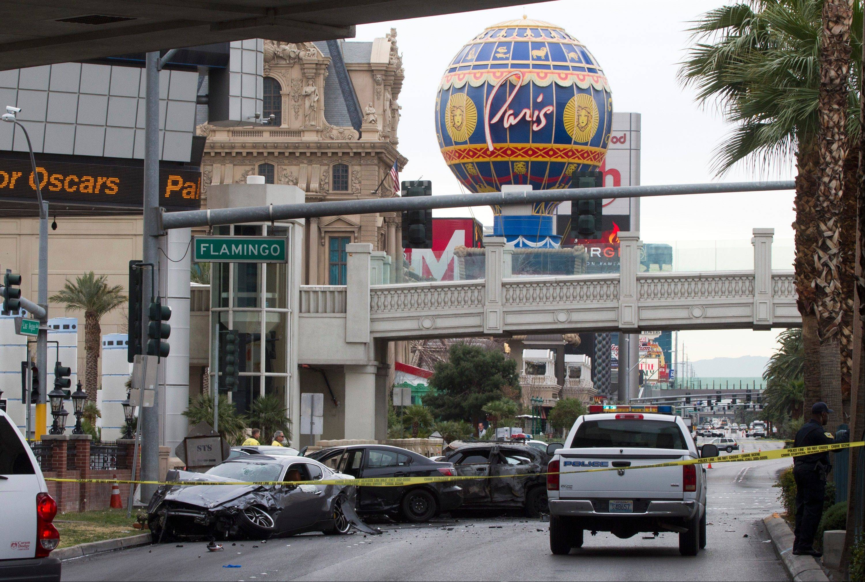 Police rope off the scene of a shooting and multi-car accident on the Las Vegas Strip in Las Vegas early Thursday