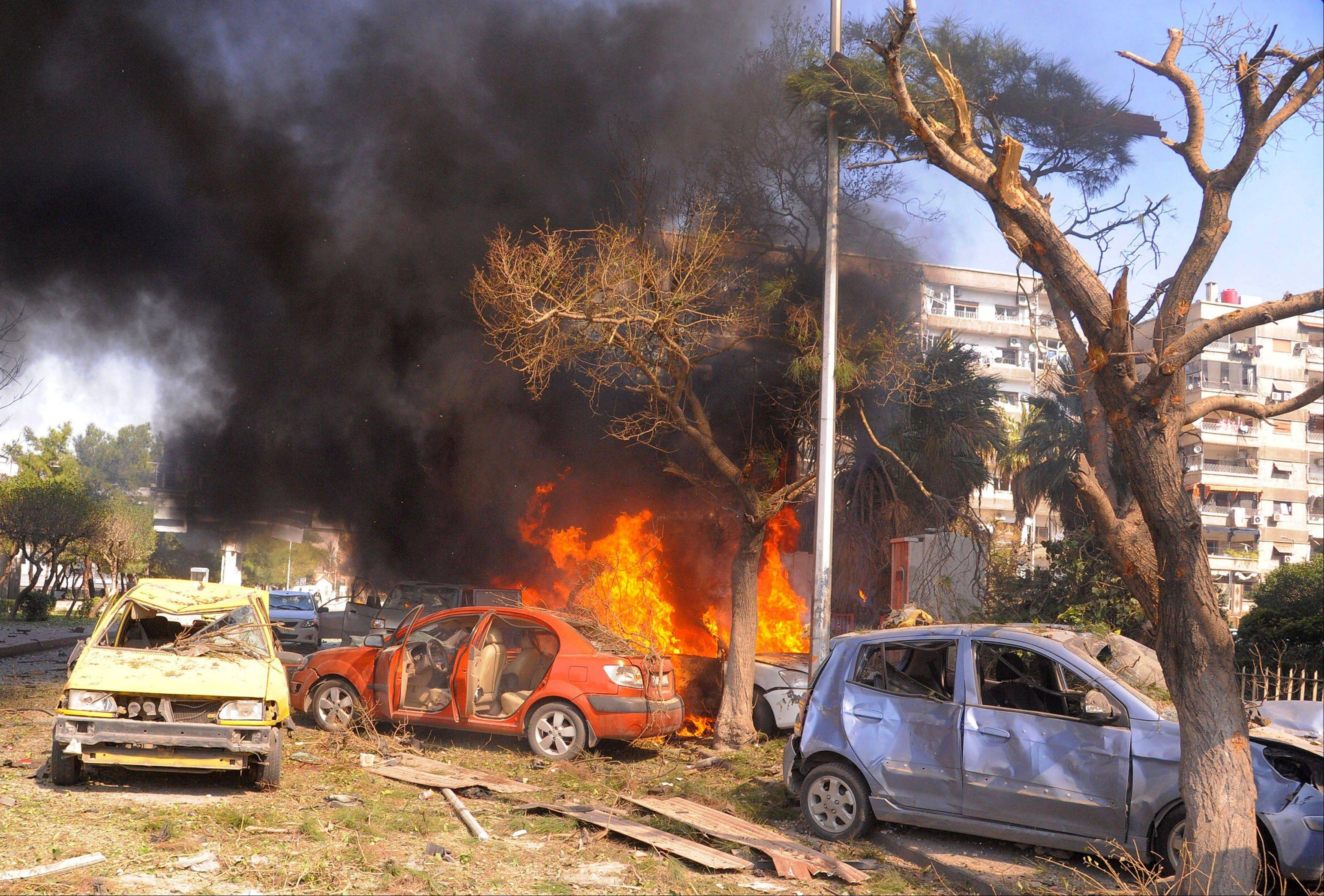A car bomb shook central Damascus on Thursday, exploding near the headquarters of the ruling Baath Party and the Russian Embassy, eyewitnesses and opposition activists said.