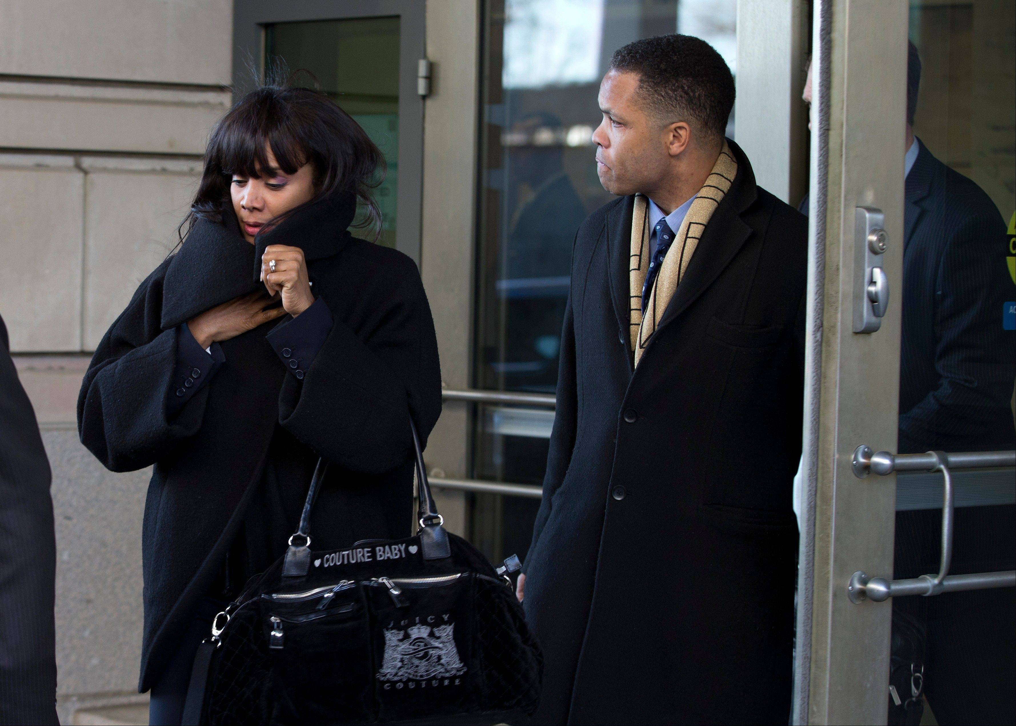 Former Illinois Rep. Jesse Jackson Jr. and his wife Sandi leave the E. Barrett Prettyman Federal Courthouse in Washington, Wednesday.