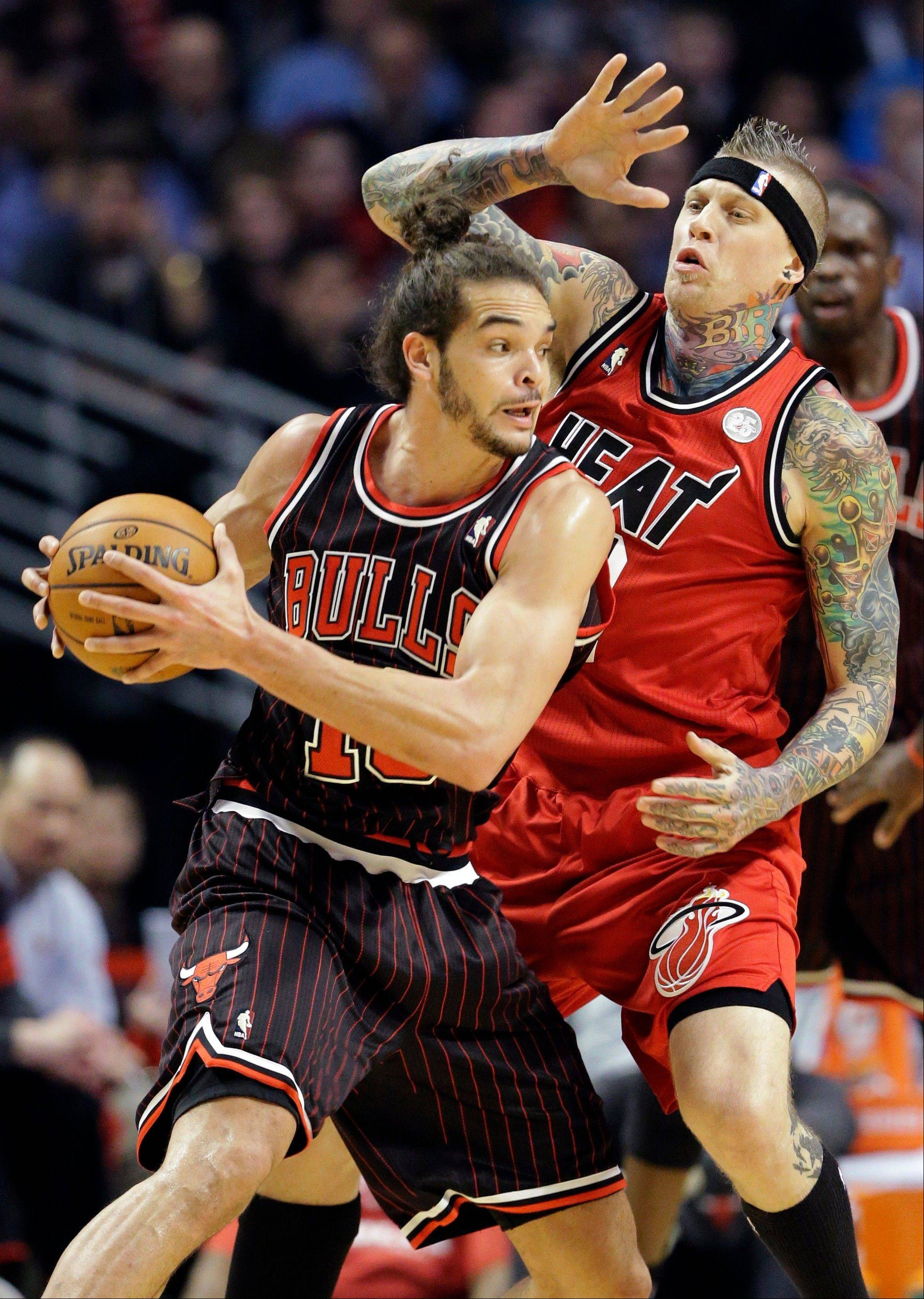 Miami Heat forward Chris Andersen, right, guards Chicago Bulls center Joakim Noah during their game Thursday night in Chicago.