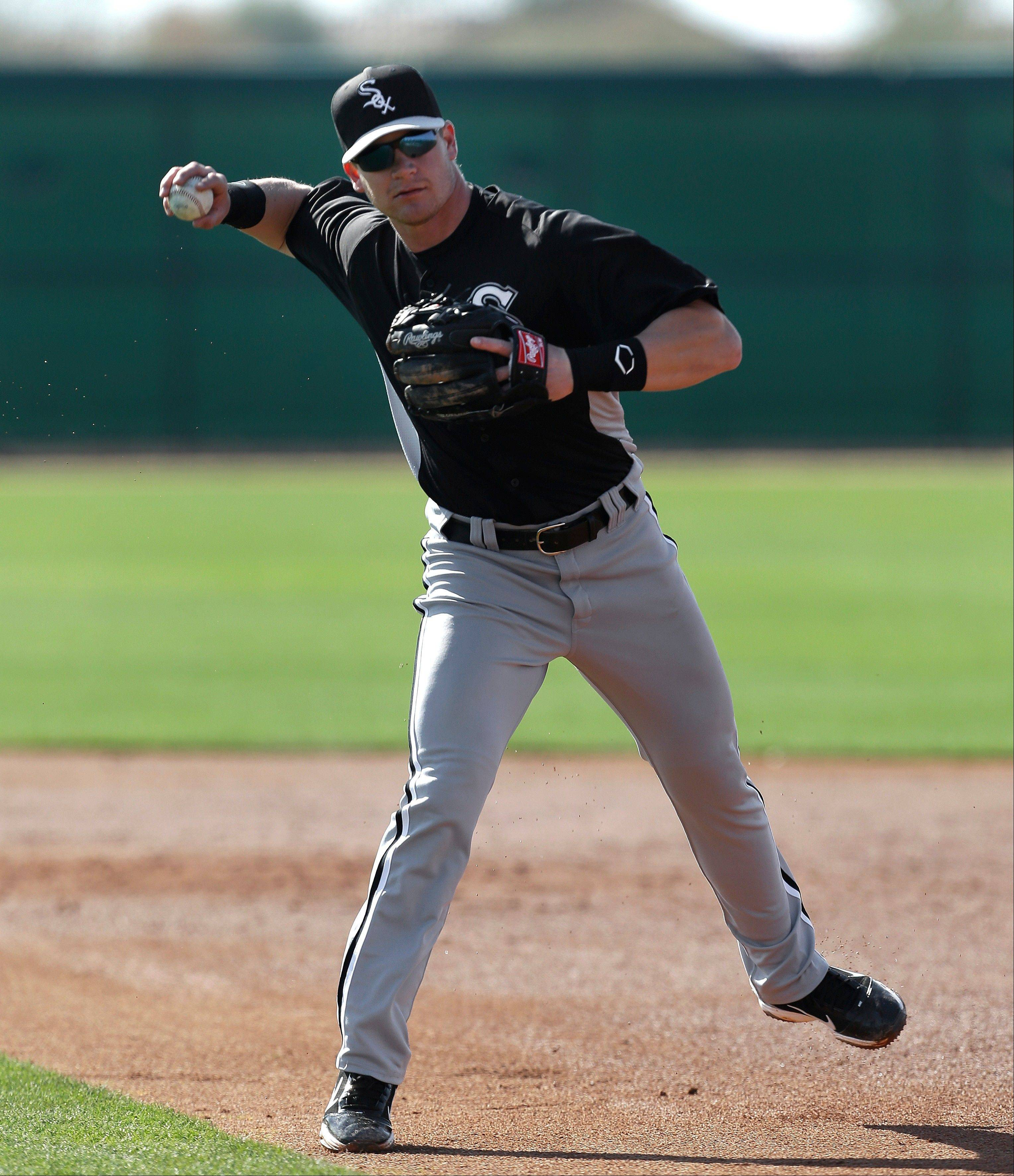 Chicago White Sox second baseman Gordon Beckham throws during spring training baseball in Phoenix, Thursday, Feb. 21, 2013.