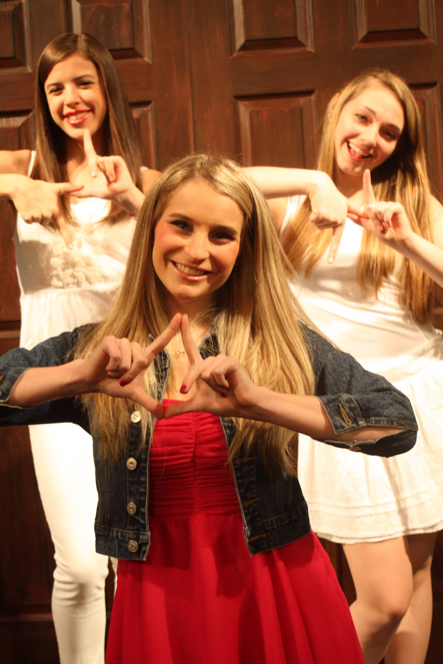 Carly Gurrieri (Elle Woods - center) and Delta Nu Sorority Sisters Alyssa Peterson (left) and Emily Miller (right) give the Delta NU sign!