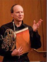 MCC faculty member Russ Henning will play French horn at the Sunday concert.