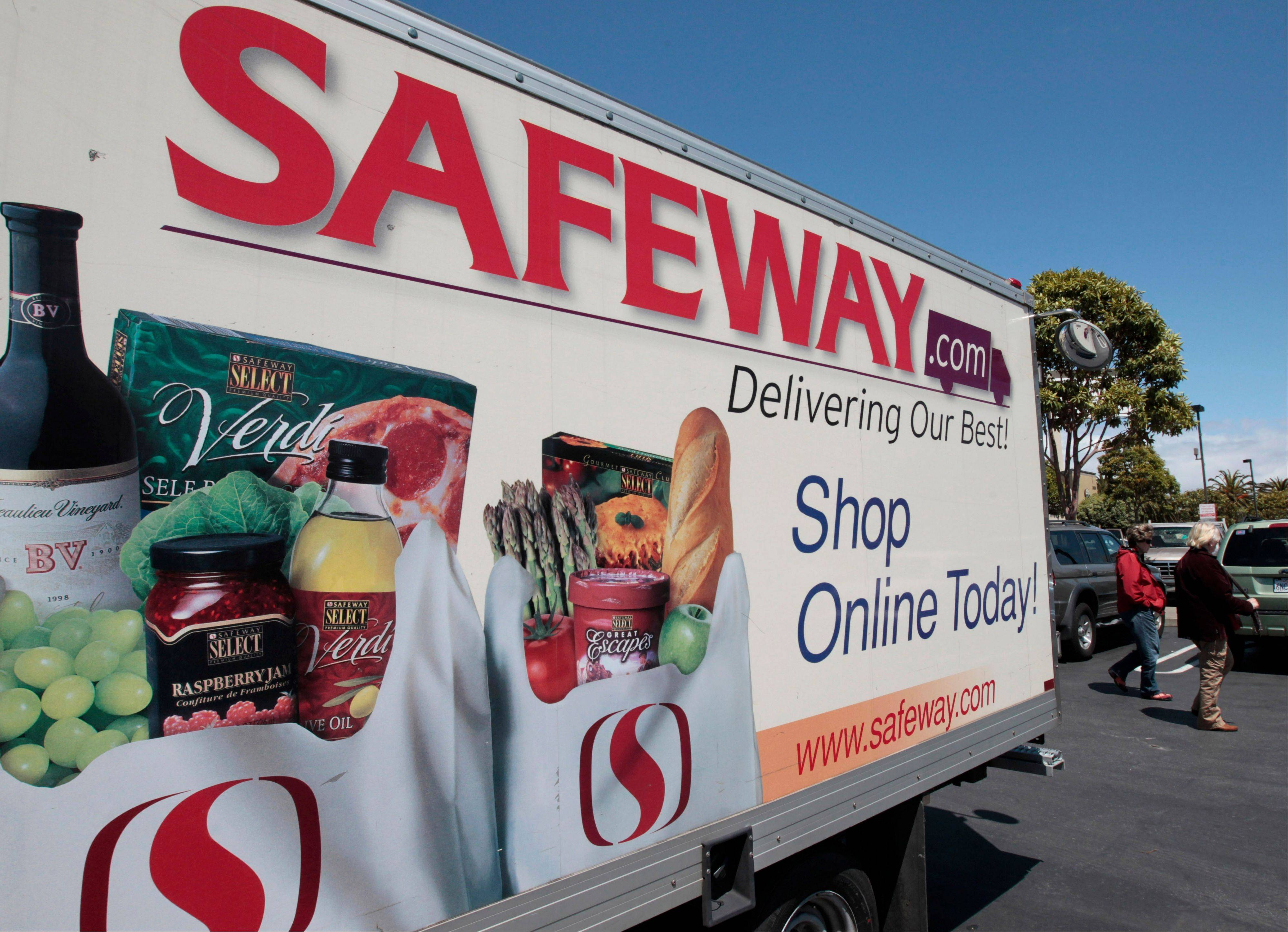 In this Thursday, April 26, 2012, file photo, a Safeway online shopping advertisement is shown at a Safeway store in San Francisco. Grocery store operator Safeway said Thursday, Feb. 21, 2013, its customer loyalty program helped its fourth-quarter net income jump 13 percent in the fourth quarter, far surpassing expectations.