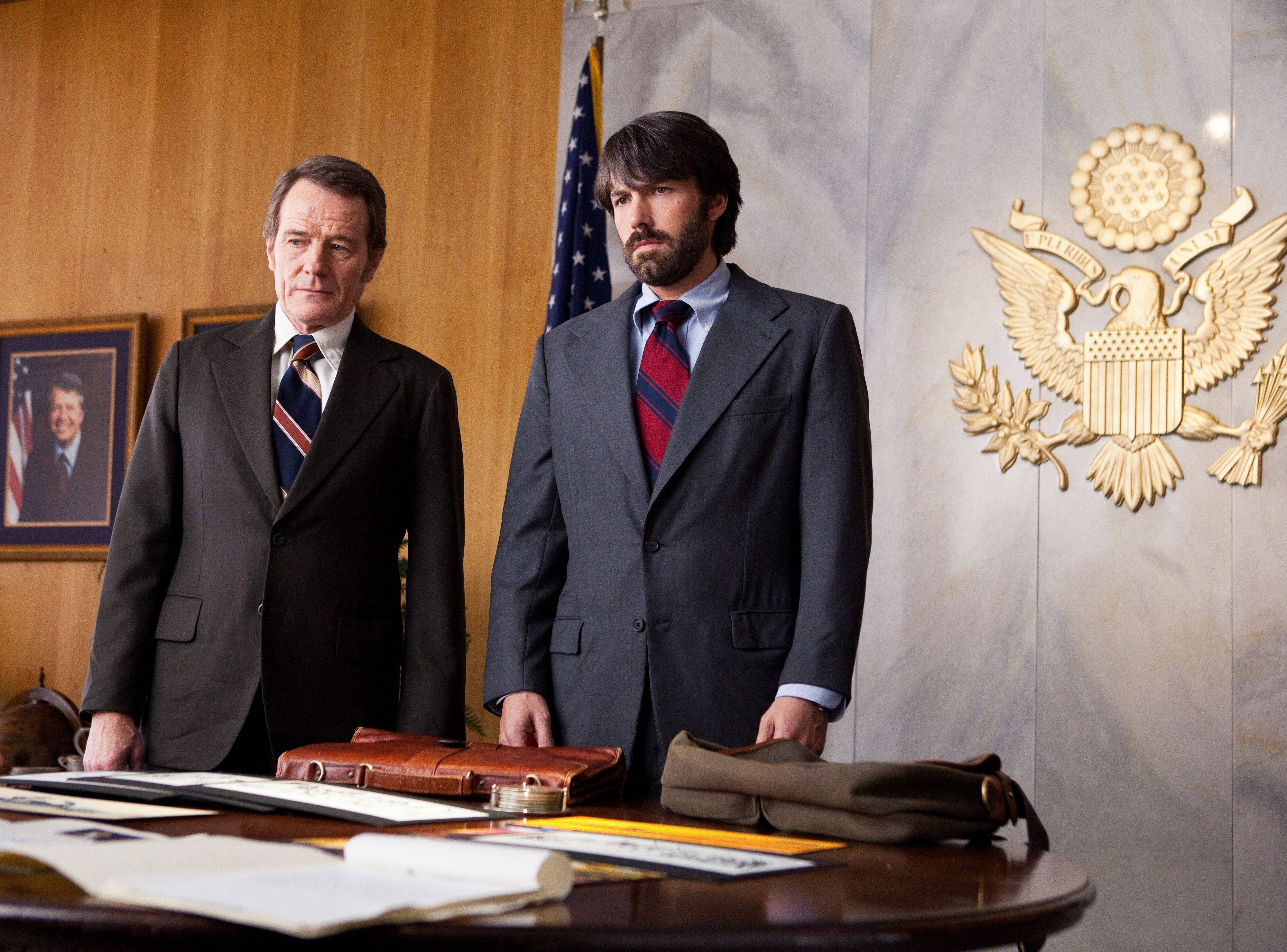 Bryan Cranston, left, plays Jack O�Donnell and Ben Affleck portrays Tony Mendez in �Argo,� a rescue thriller about the 1979 Iranian hostage crisis.