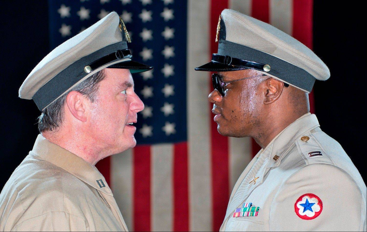 "Schaumburg resident Tim Walsh, left, plays Captain Charles Taylor opposite Frank Pete's Captain Richard Davenport in Raven Theatre's 30th anniversary revival of Charles Fuller's Pulitzer Prize-winning ""A Soldier's Play."""