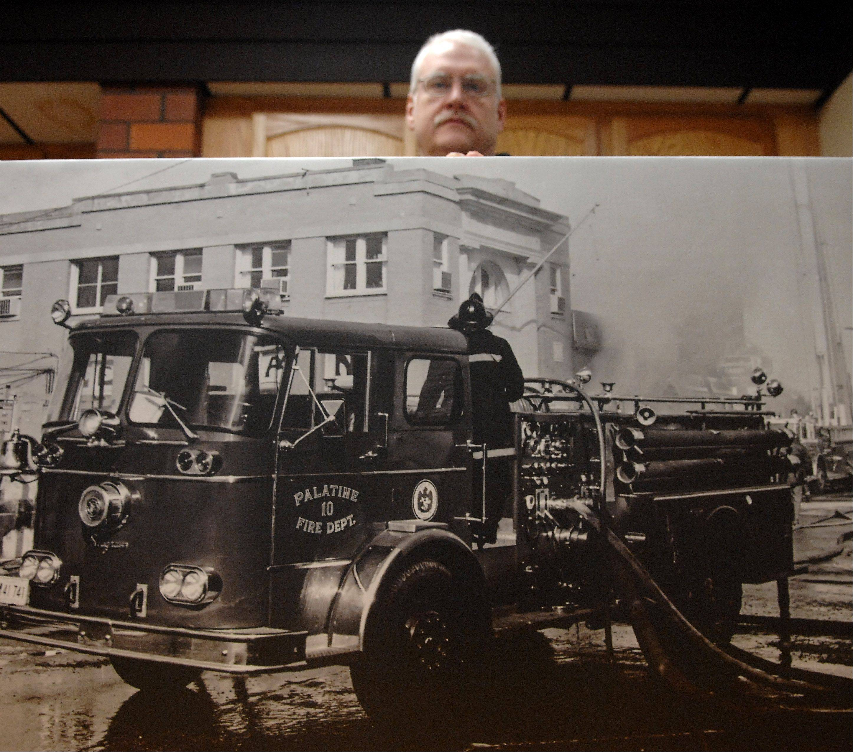 Rick West/rwest@dailyherald.com Elgin firefighter John Tobin has written a book about the Ben Franklin Variety Store fire that killed three Palatine volunteer firefighters 40 years ago.