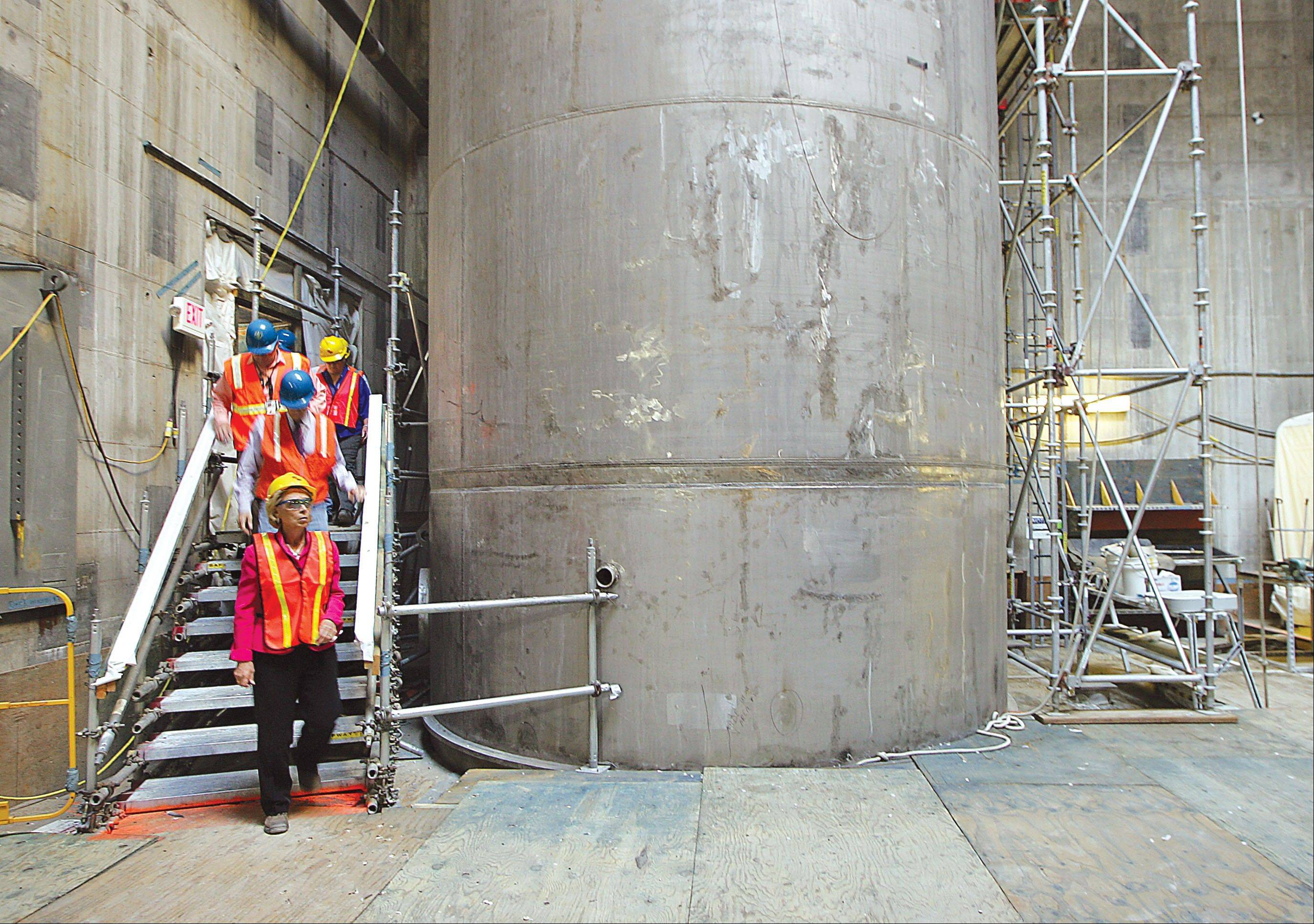 Associated Press/Sept. 18, 2012 Then-Gov. Chris Gregoire makes her way down a set of stairs at the Hanford Vitrification Plant in Richland, Wash. Six underground radioactive waste tanks at the nation�s most contaminated nuclear site are leaking, Gov. Jay Inslee said Friday.