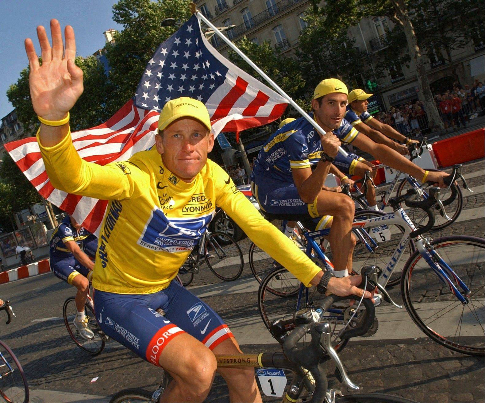 U.S. Postal Service cycling team leader and 2004 Tour de France winner Lance Armstrong, wearing the overall leader�s yellow jersey, and teammate George Hincapie, right, ride the victory lap on Champs Elysees boulevard in Paris, France. Lawyers for Armstrong say the Justice Department has joined a lawsuit against the cyclist.