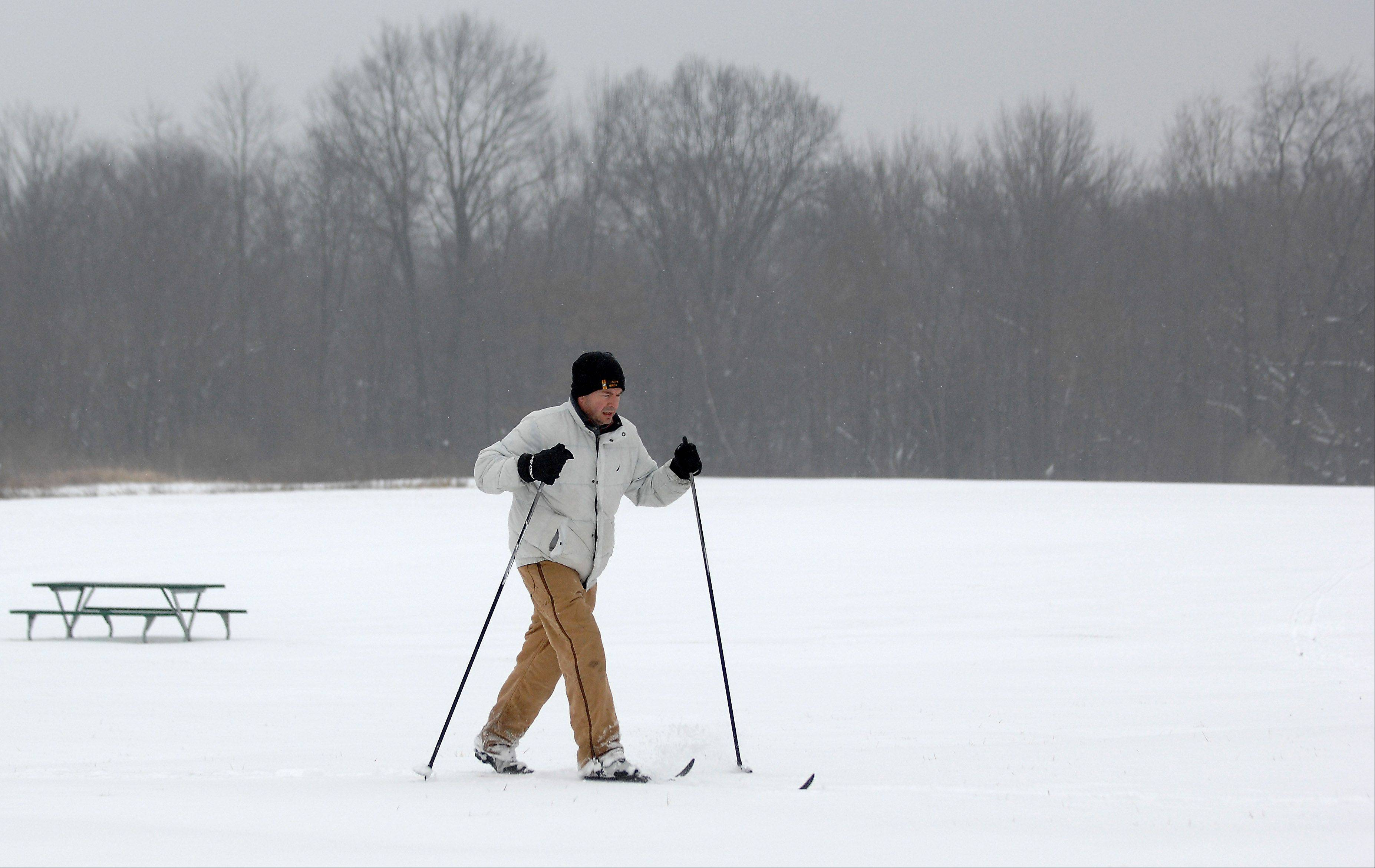 Mike Wolfe of Bartlett takes advantage of the fresh snow to do some cross country skiing at LeRoy Oakes Forest Preserve in St. Charles Friday.