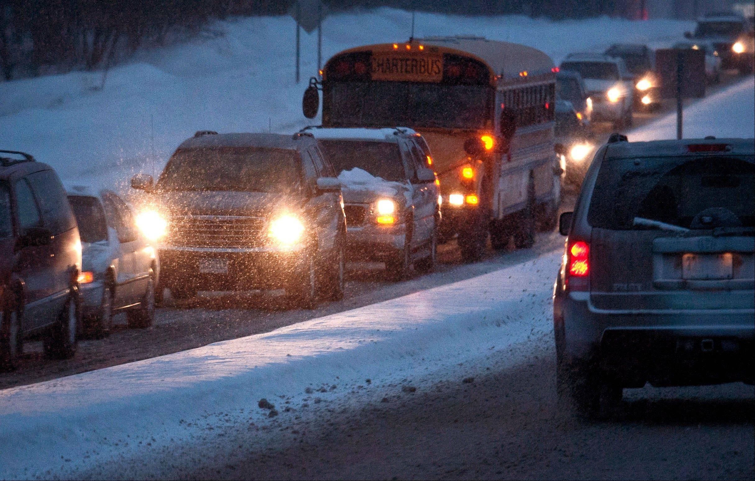 Heavy snow made for slow traffic early Friday morning along Diffley Road in Eagan, Friday, Feb. 22, 2013. A major snowstorm that buried parts of the Midwest grazed Minnesota, where two to three inches of snow snarled the morning commute in the Twin Cities area.
