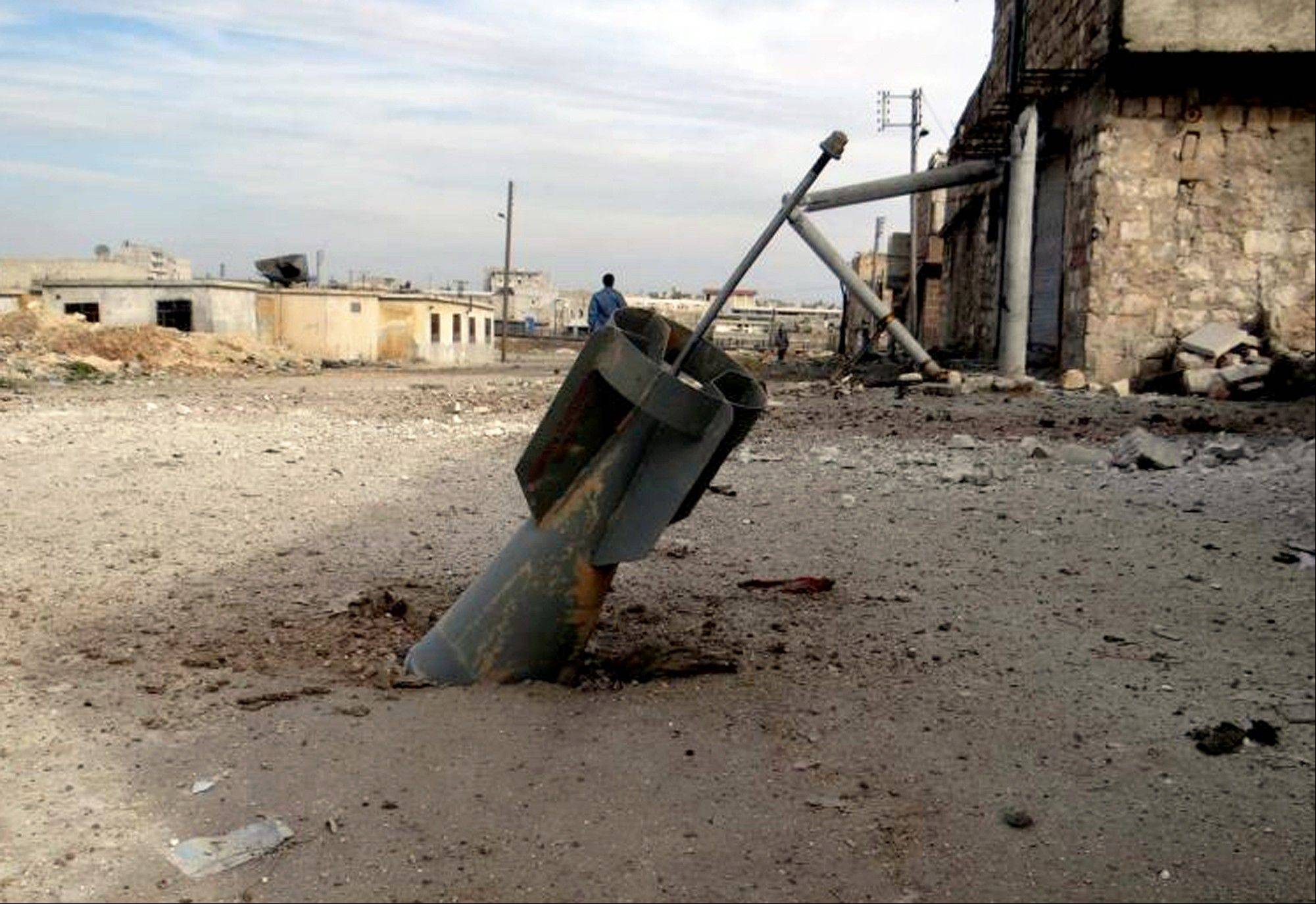 An unexploded rocket from a Syrian warplane, in the neighborhood of Karam Alqasir, near Aleppo International Airport, in Aleppo, Syria, Thursday, Feb. 21, 2013. A car bomb near the Damascus headquarters of Syria�s ruling party killed scores on Thursday, while a government airstrike on a rebel field hospital in southern Daraa left several dead, opposition activists and state media reported.