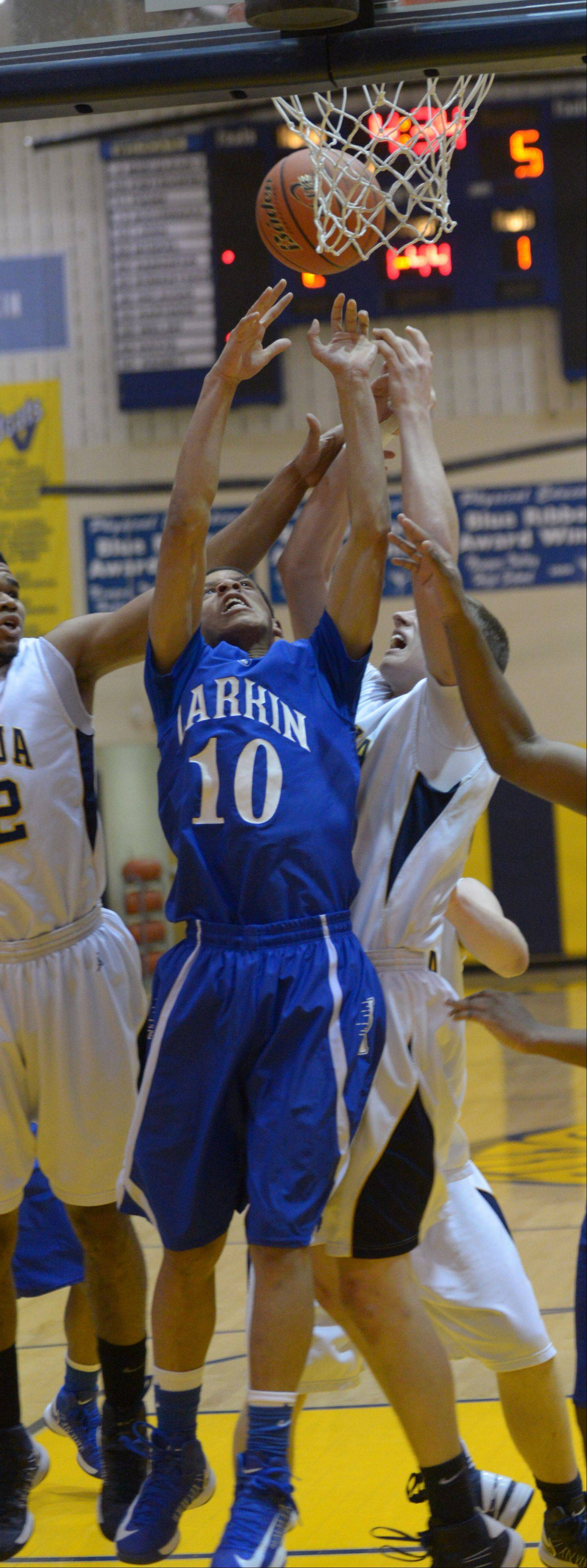 Kendale McCullum of Larkin goes up for a rebound Friday night at Neuqua Valley.