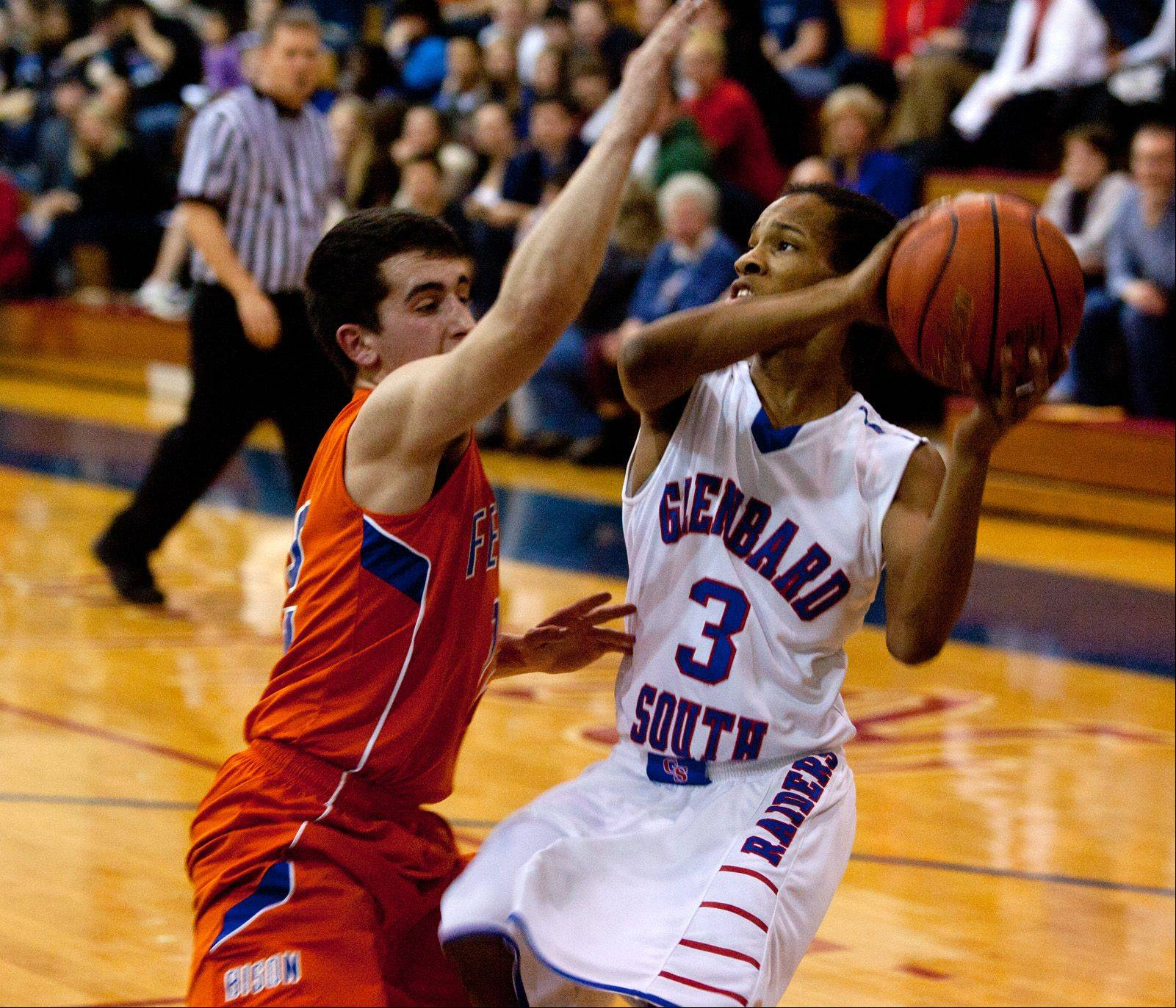 Glenbard South�s Chaun Rickette (3), eyes the basket for a pair of his 16 first quarter points against Fenton.