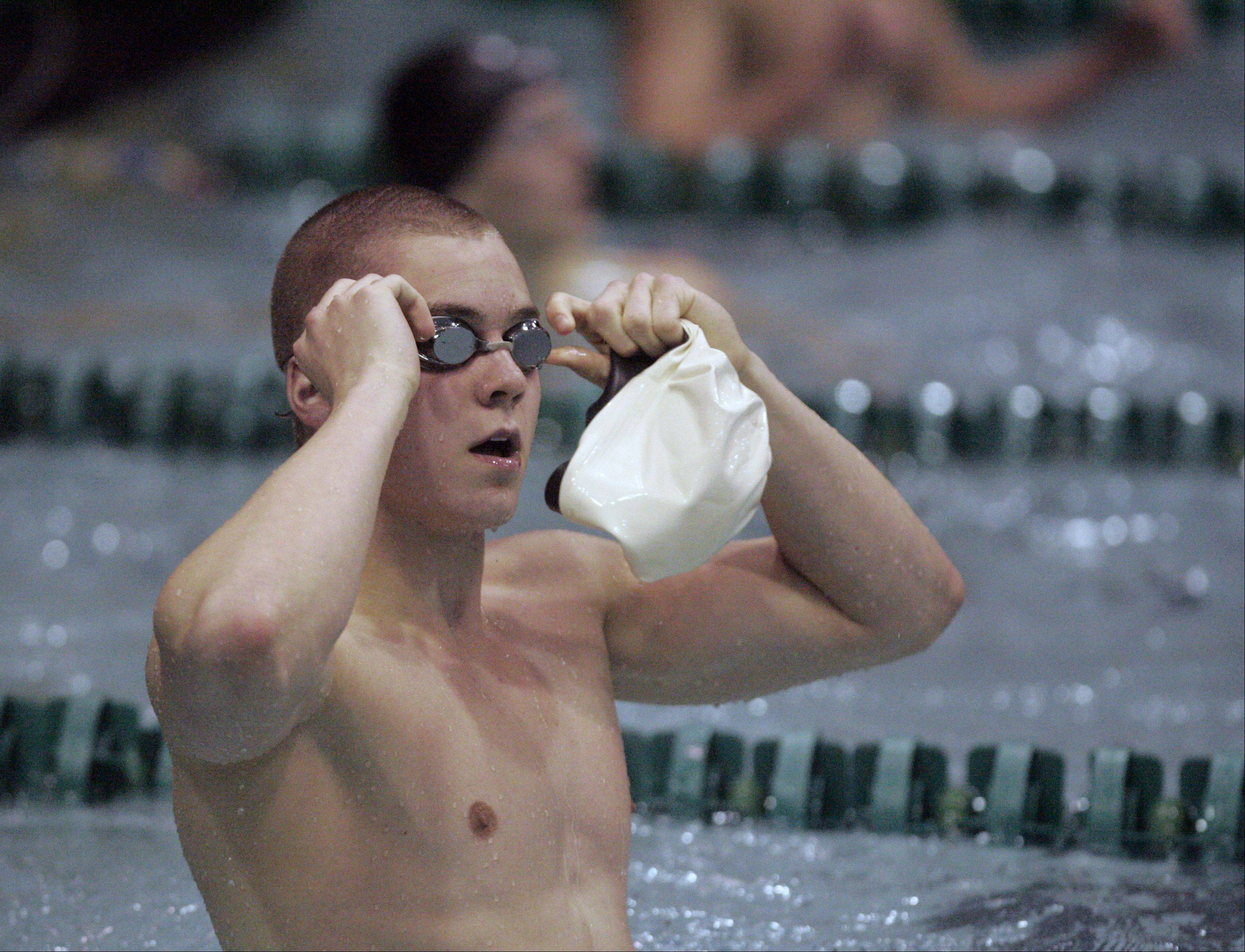 Adam Stacklin of Waubonsie Valley reacts to his time in the 100-yard freestyle during the IHSA State Swimming Prelims at New Trier High School in Winnetka Friday.