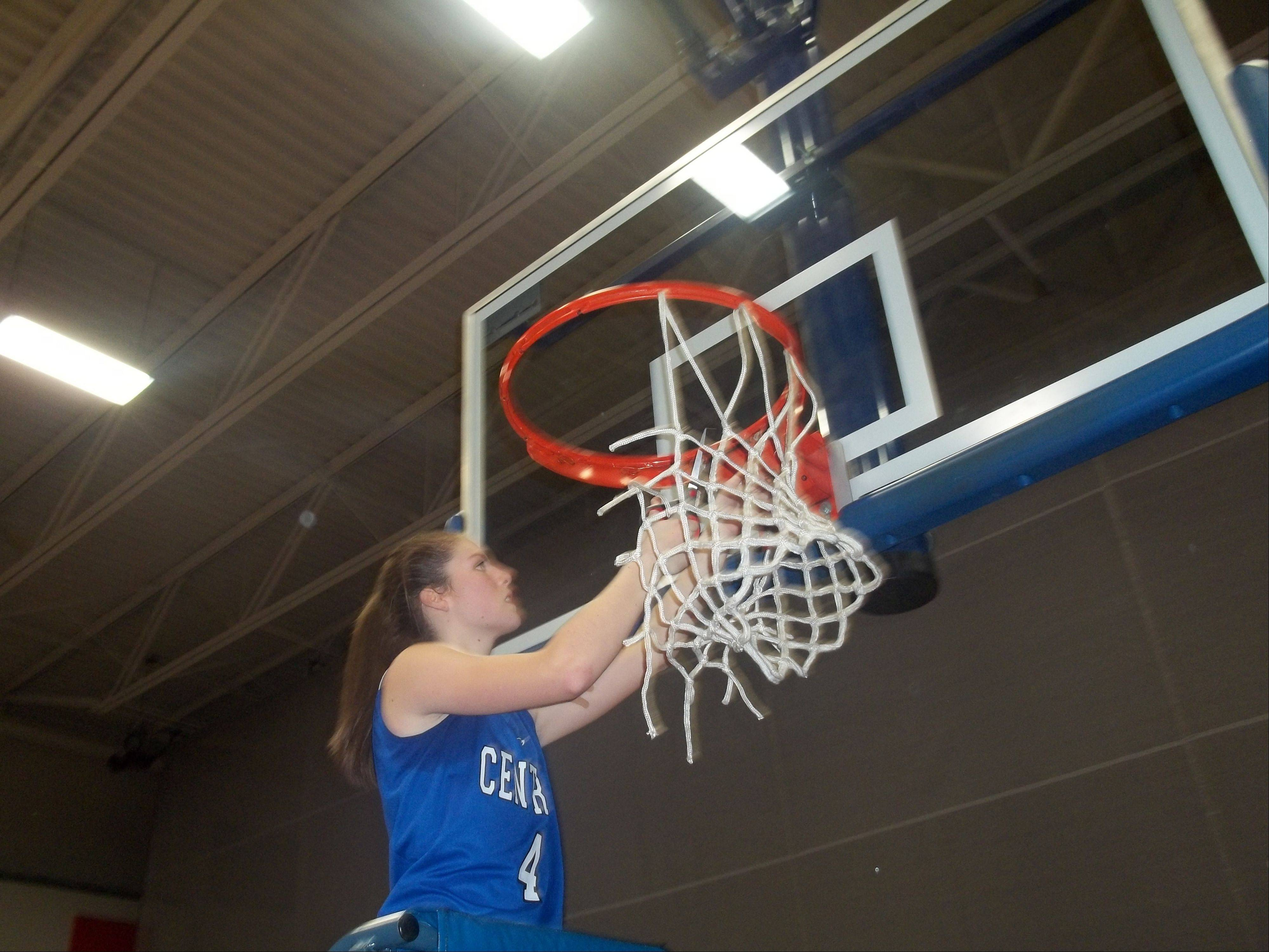 Burlington Central freshman Kayla Ross cuts a piece of the net Thursday after the Rockets� 49-26 win over Sterling in the Class 3A Genoa-Kingston sectional championship game.